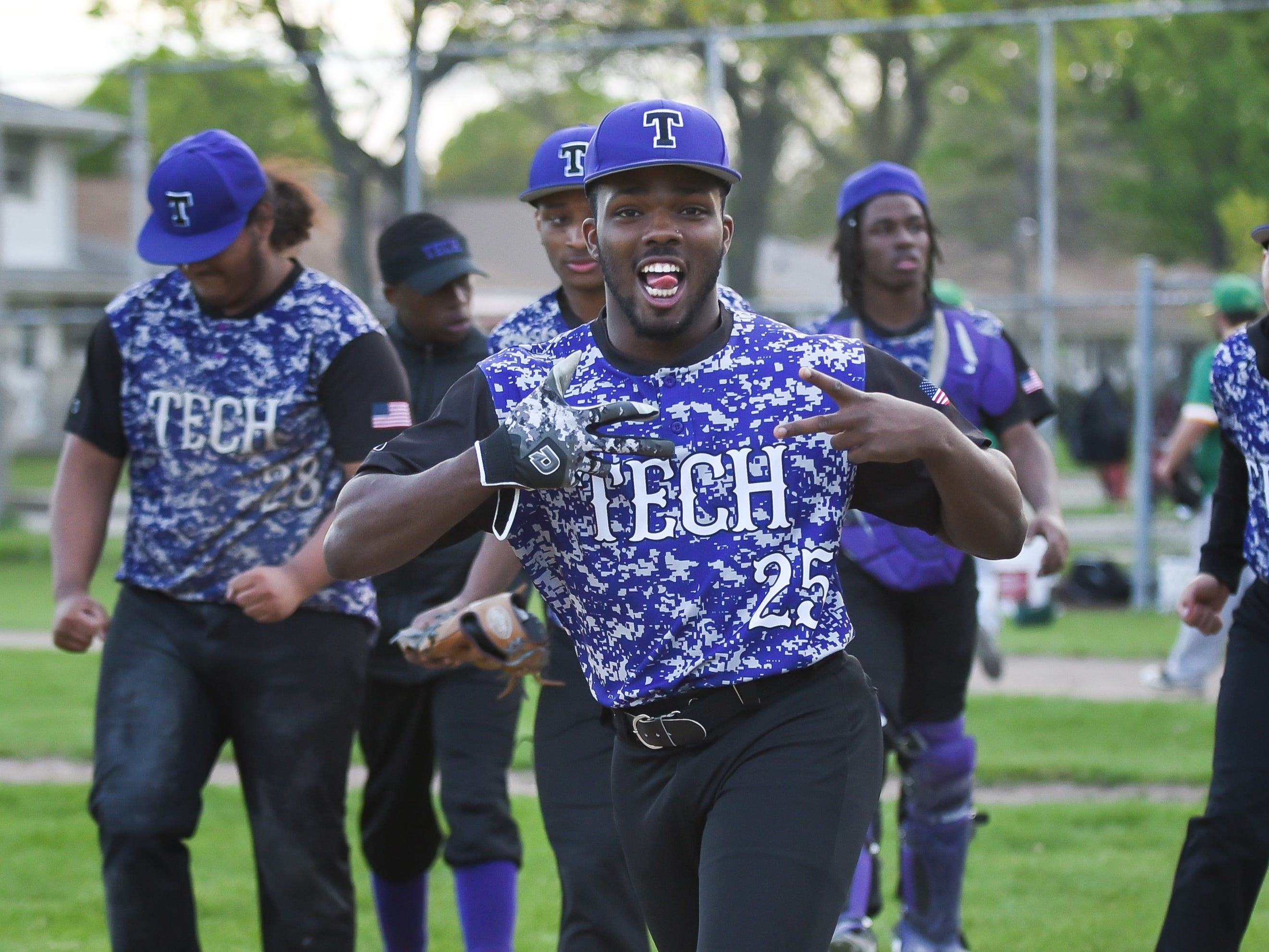 Milwaukee Bradley Tech outfielder Rayshawn Simpson hams it up after Tech beat Milwaukee Hamilton, 3-1, in a City Conference baseball game Tuesday, May 14, 2019, at Hogan Field at Hamilton High School.