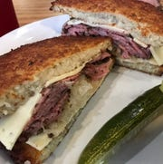 The Epiphany sandwich at Benji's Deli & Restaurant stacks pastrami with sauerkraut and Swiss cheese between two potato pancakes.