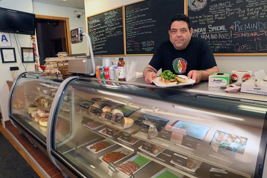Damien Scardina holds a mortadella sandwich called u'puarco at Scardina Specialties, 822 E. Chambers St. in the Riverwest neighborhood. Besides making panini and other sandwiches, the deli creates sausages, salads, pizzas and other items.