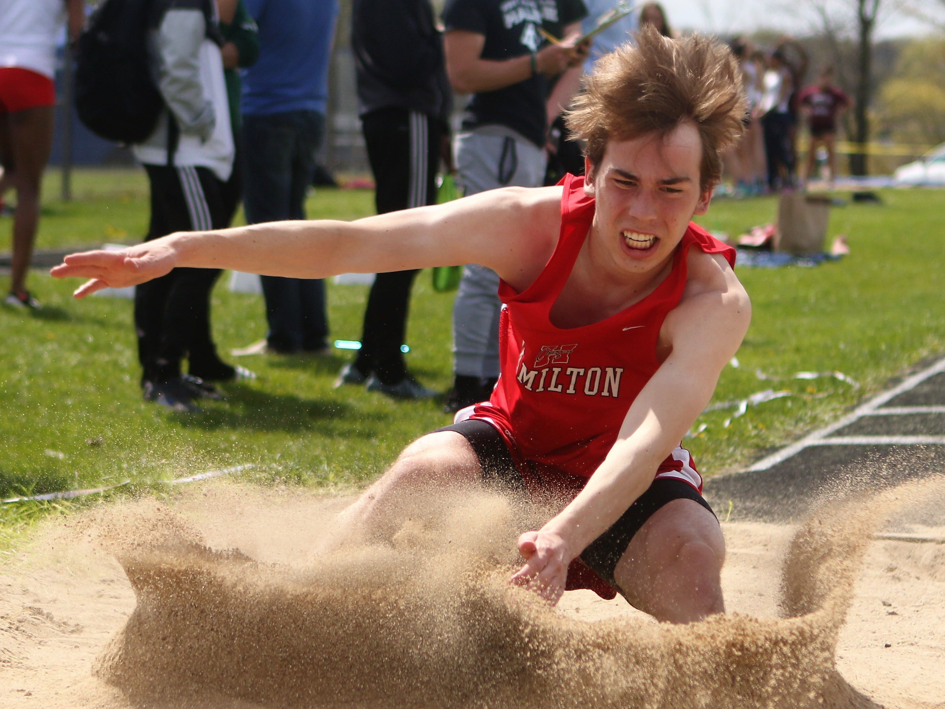 Sussex Hamilton's Joey Geels lands during the long jump competition at the Greater Metro Conference meet on May 14, 2019.
