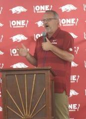 Arkansas women's basketball coach Mike Neighbors speaks at the ONE Razorback Roadshow on Tuesday night at the Baxter County Fairgrounds.