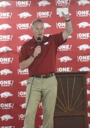 University of Arkansas vice chancellor and director of athletics Hunter Yurachek speaks to the crowd at the Baxter County Fairgrounds on Tuesday night.