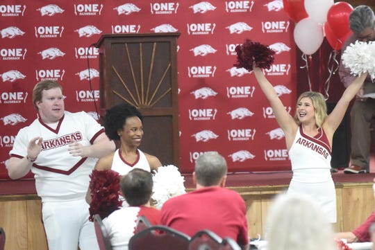Arkansas Razorback spirit squad members Kedrin Rayburn (left) and Alexis Ungerank (right), both of Mountain Home, cheer at the ONE Razorback Roadshow on Tuesday night.
