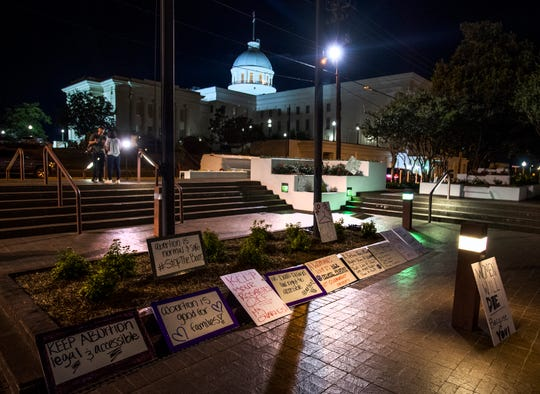 Anti abortion ban bill protestors lay out signs outside of the Alabama statehouse after HB314, the near-total ban on abortion bill, passed the senate in Montgomery, Ala., on Tuesday May 14, 2019.