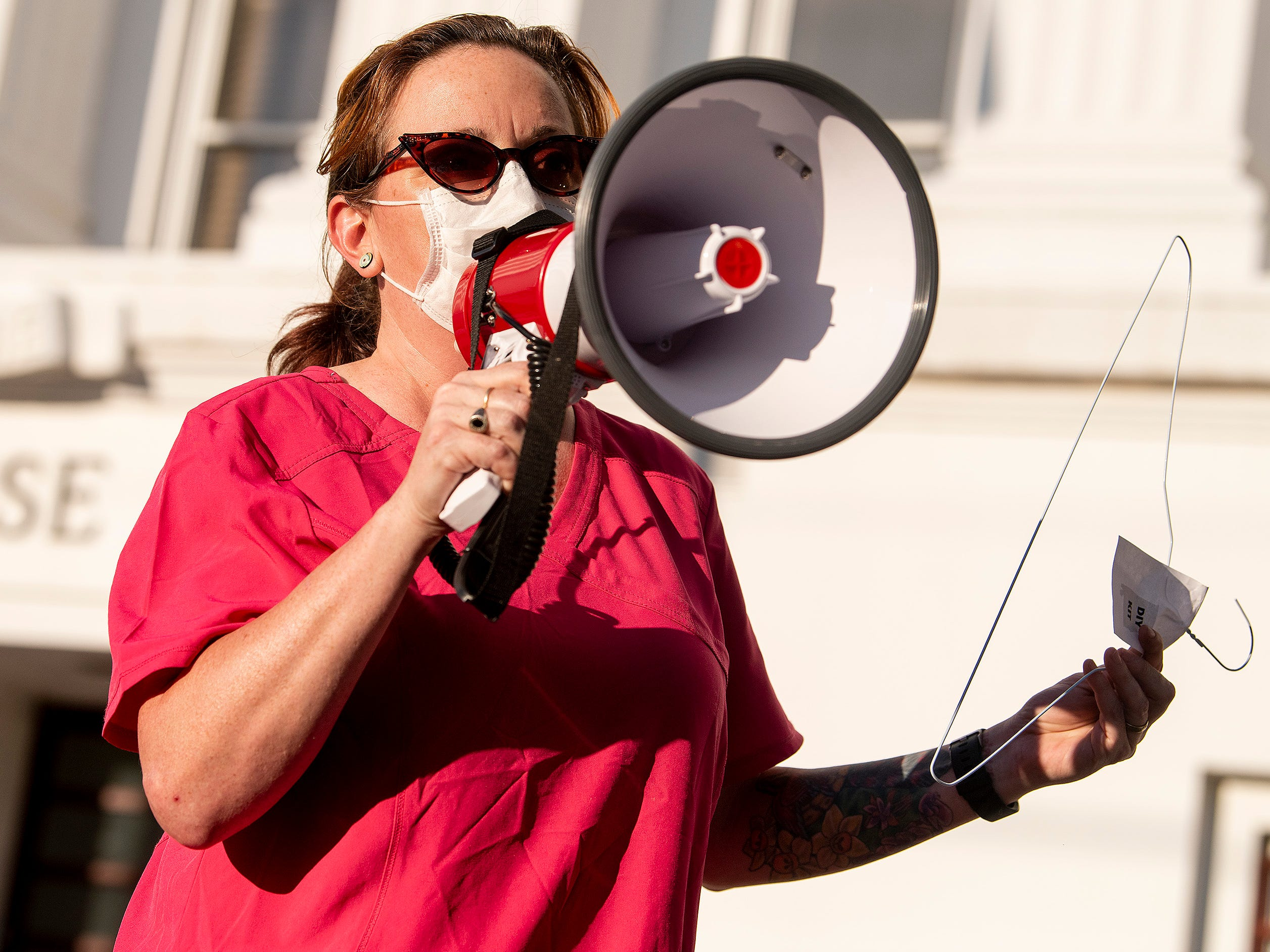 Laura Stiller discusses illegal abortions during a rally against HB314, the near-total ban on abortion bill, outside of the Alabama Statehouse in Montgomery, Ala., on Tuesday May 14, 2019.