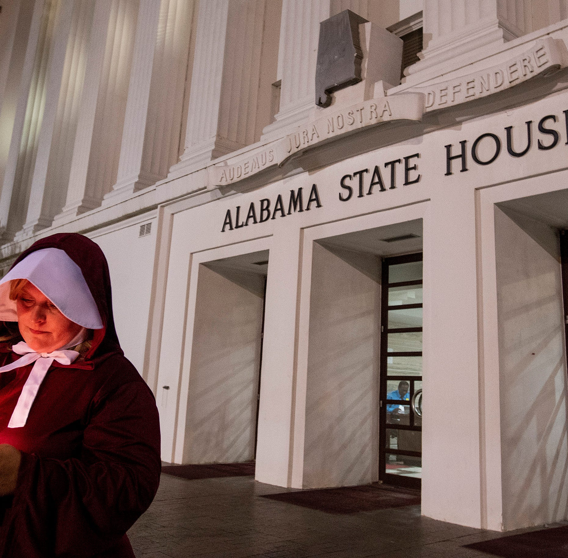 How does Alabama's near-total abortion ban bill compare to Georgia's 'fetal heartbeat' law?