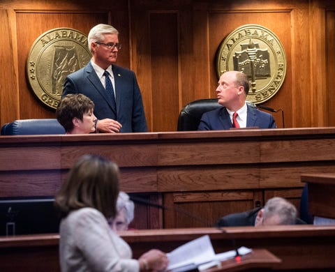 Lt. Governor Will Ainsworth, right, talks with Sen. Greg Reed during debate on HB314, the near-total ban on abortion bill, is held in the senate chamber in the Alabama Statehouse in Montgomery, Ala., on Tuesday May 14, 2019.