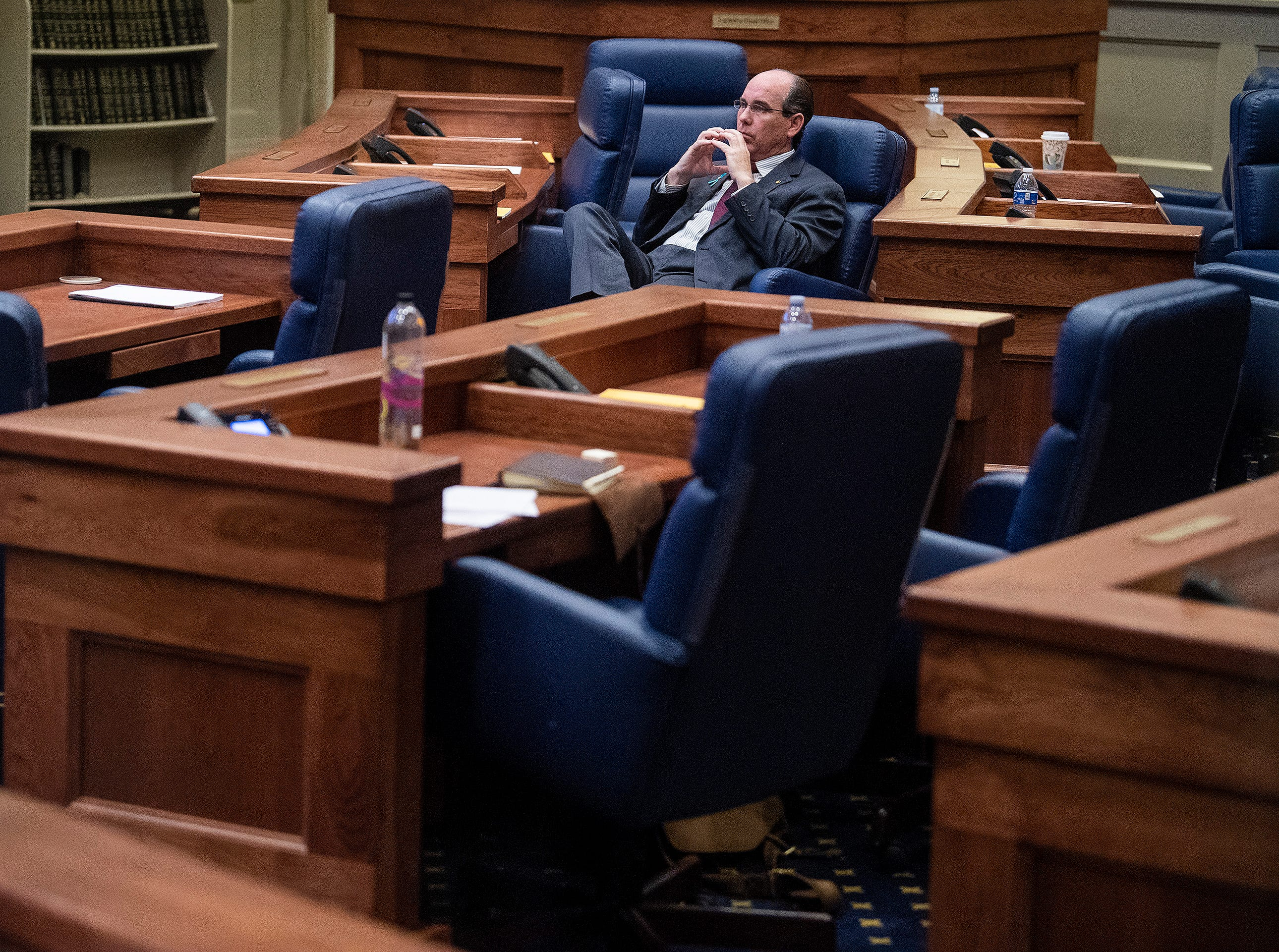 Sen Clyde Chambliss sits alone during debate on HB314, the near-total ban on abortion bill, in the senate chamber in the Alabama Statehouse in Montgomery, Ala., on Tuesday May 14, 2019.