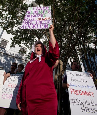 Bianca Cameron-Schwiesow chants during a rally against HB314, the near-total ban on abortion bill, outside of the Alabama Statehouse in Montgomery, Ala., on Tuesday May 14, 2019.