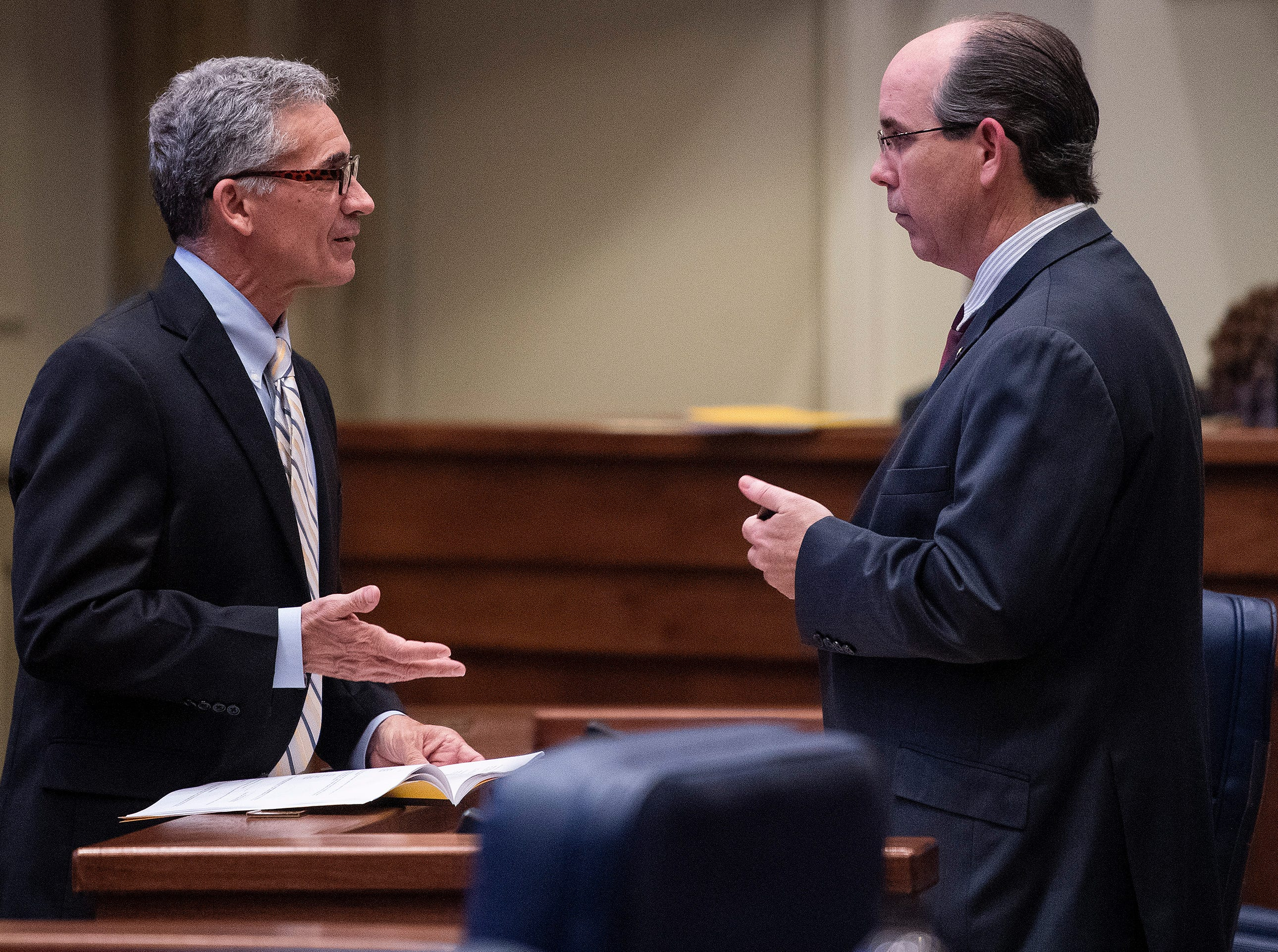 Sen. Del Marsh, left, and Sen. Clyde Chambliss chat as debate on HB314, the near-total ban on abortion bill, is held in the senate chamber in the Alabama Statehouse in Montgomery, Ala., on Tuesday May 14, 2019.
