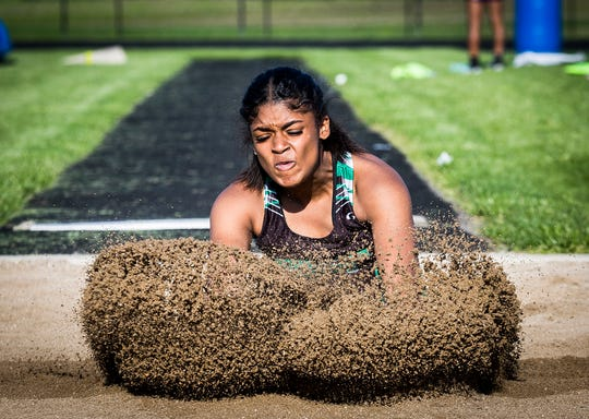 Yorktown's Talia Morgan competes in the long jump during the girls track sectional at Delta High School Tuesday, May 14, 2019.