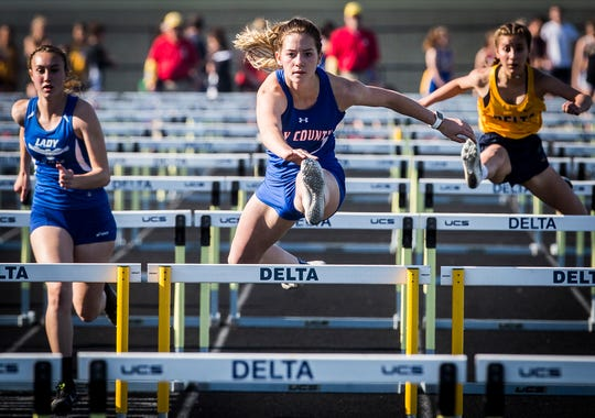 Jay County's Abby Benter competes in the 100 meter hurdles during the girls track sectional at Delta High School Tuesday, May 14, 2019.