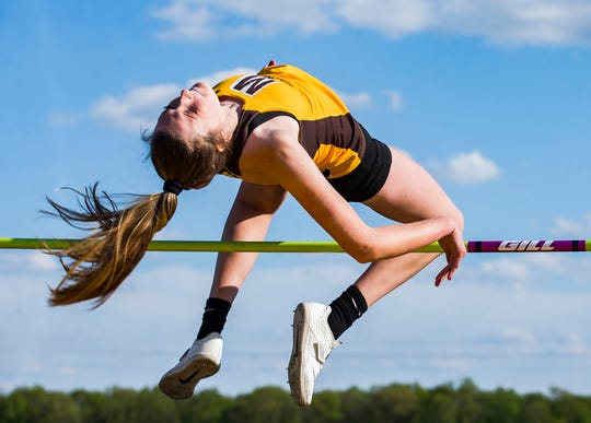 Monroe Central's Miranda Haney competes in the high jump during the girls track sectional at Delta High School Tuesday, May 14, 2019.