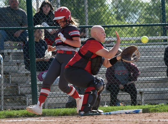 Utica senior Sydney Hoover, shown here scoring during a 2019 tournament game, has to re-open her recruitment after Franklin University closed its branch campus Urbana University on Tuesday. Hoover had signed a letter of intent to play softball at Urbana.