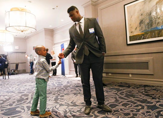 Duke's Zion Williamson stands with his young brother Noah Anderson before the NBA basketball draft lottery Tuesday, May 14, 2019, in Chicago. (AP Photo/Nuccio DiNuzzo)