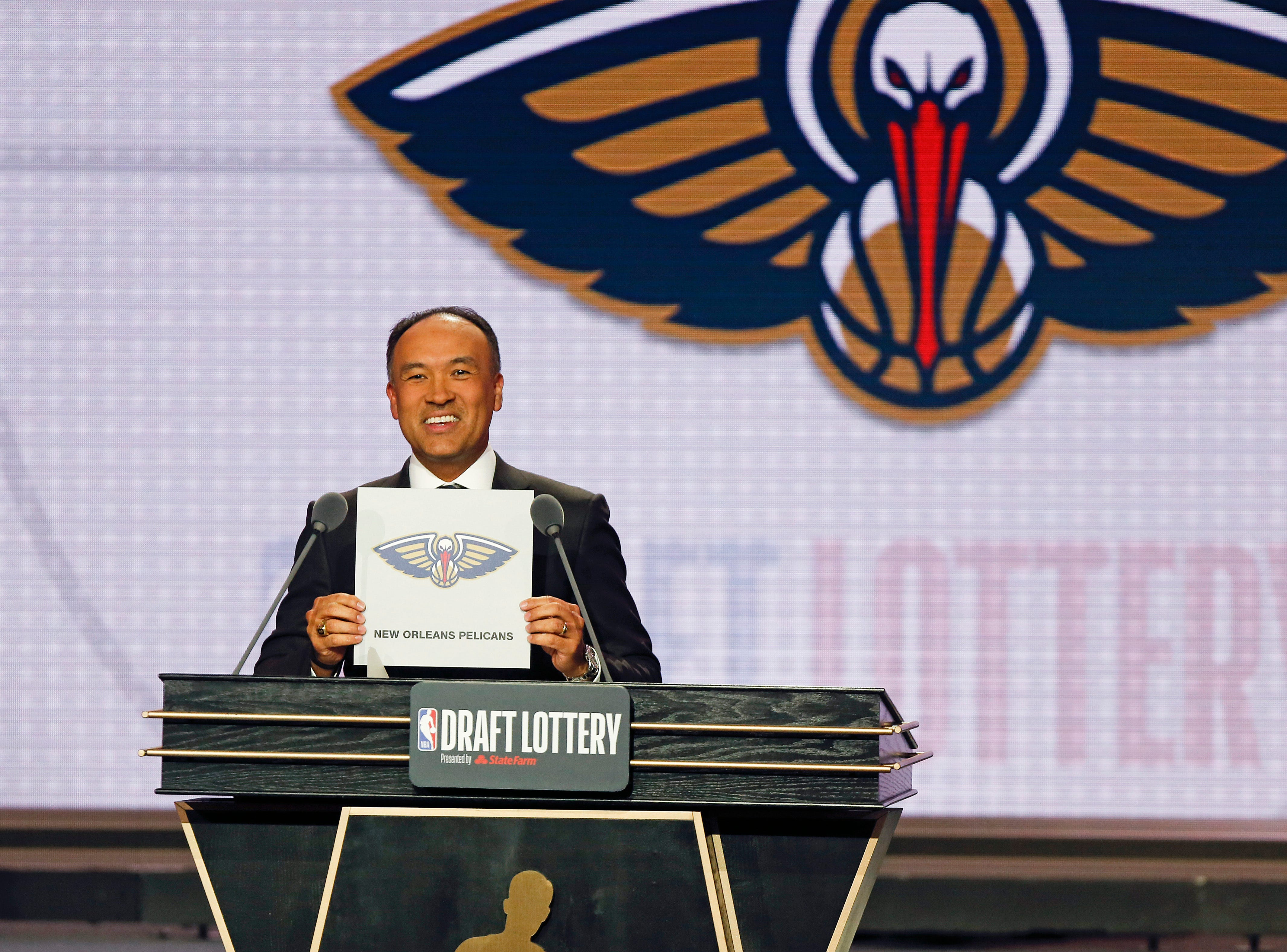 NBA Deputy Commissioner Mark Tatum announces that the New Orleans Pelicans had won the first pick during the NBA basketball draft lottery Tuesday, May 14, 2019, in Chicago. (AP Photo/Nuccio DiNuzzo)