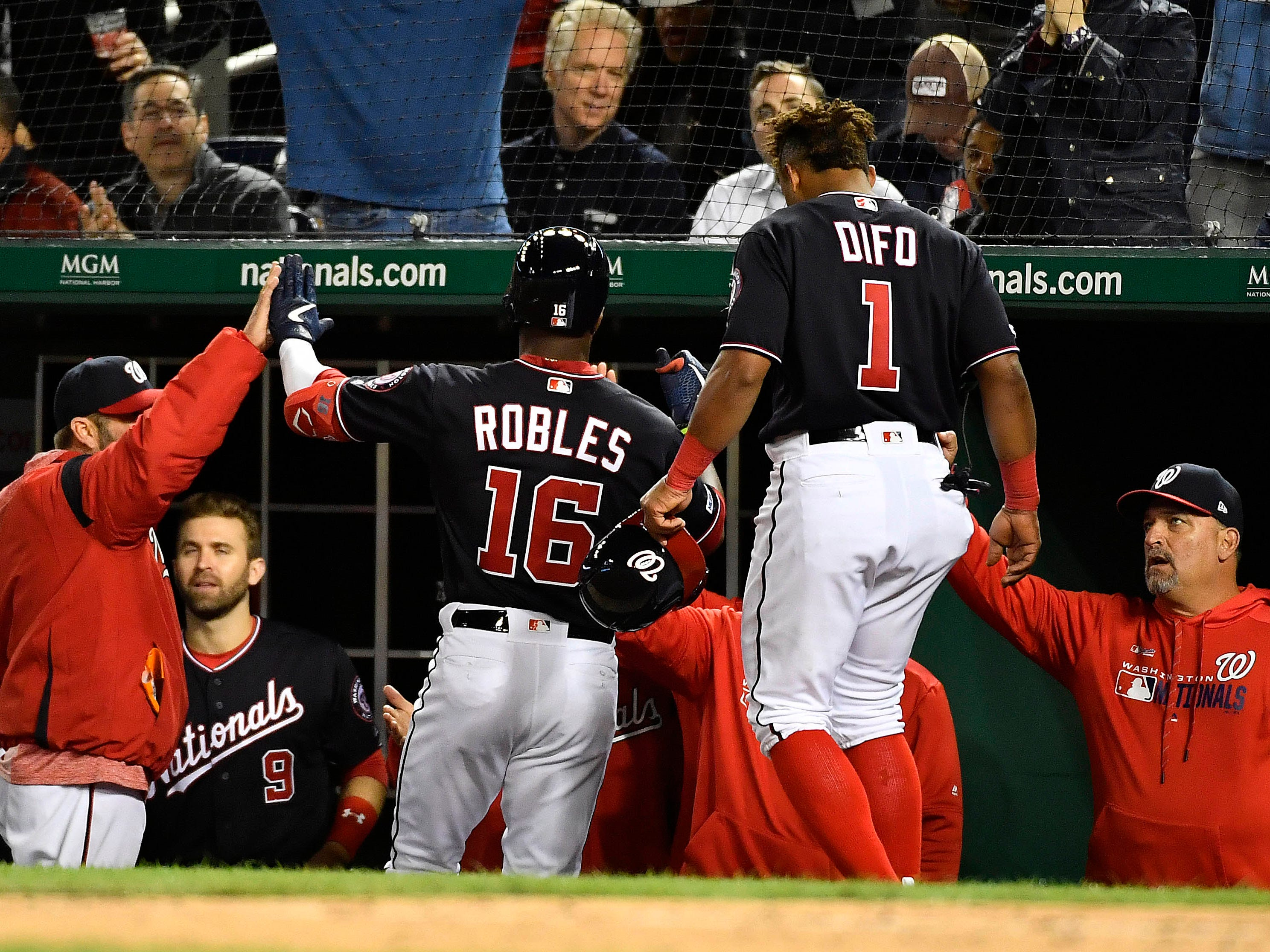 May 14, 2019; Washington, DC, USA; Washington Nationals center fielder Victor Robles (16) is congratulated by teammates after hitting a two run home run against the New York Mets during the sixth inning at Nationals Park.
