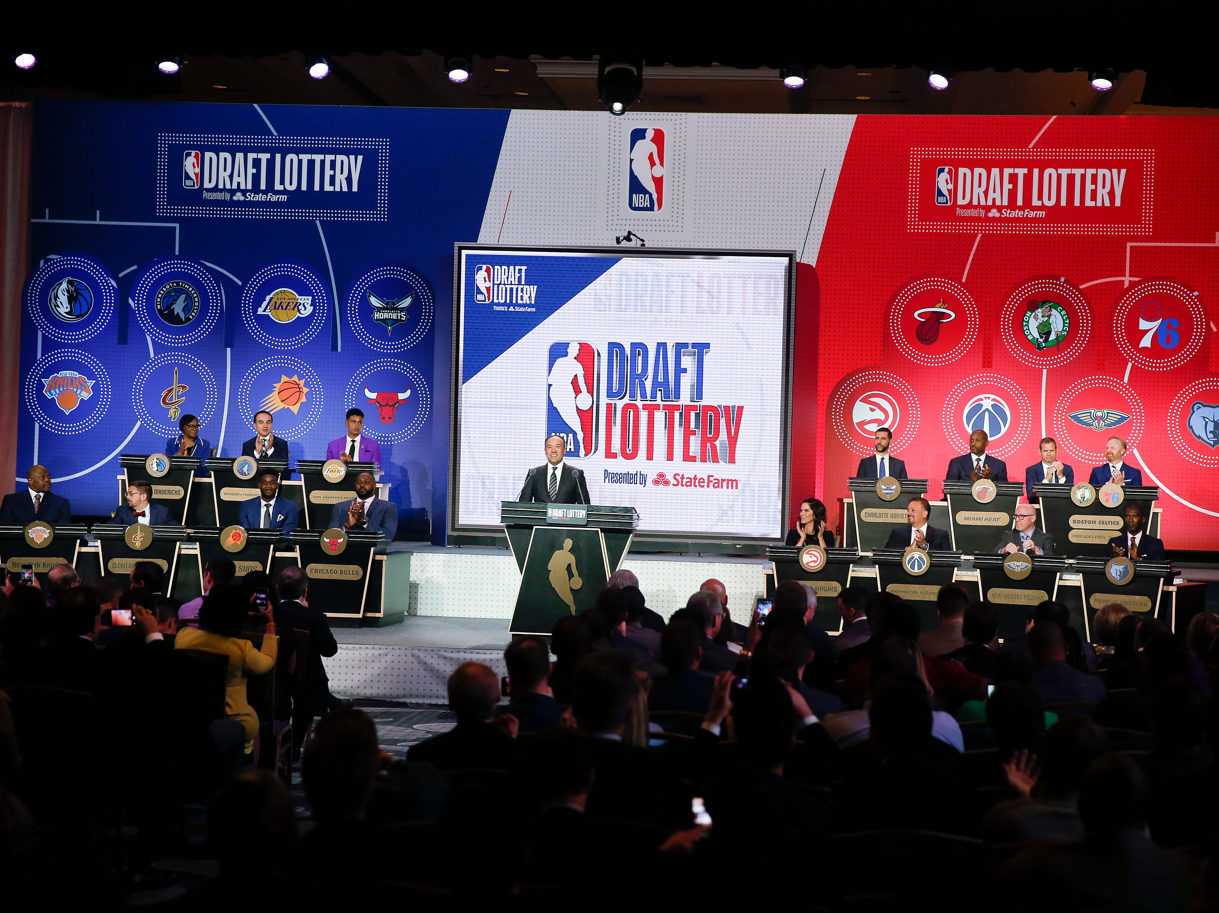 NBA Deputy Commissioner Mark Tatum gets ready to announce the order of the picks during the NBA basketball draft lottery Tuesday, May 14, 2019, in Chicago. (AP Photo/Nuccio DiNuzzo)
