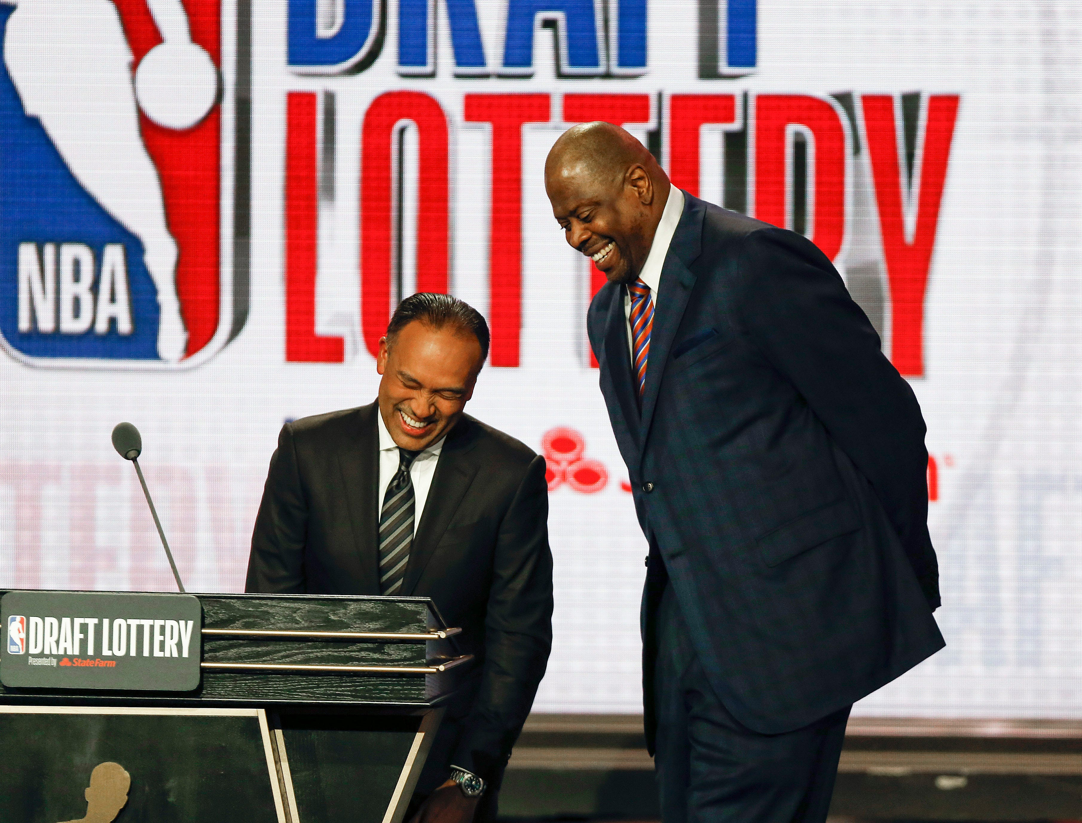 NBA Deputy Commissioner Mark Tatum, left, laughs with Patrick Ewing of the New York Knicks during the NBA basketball draft lottery Tuesday, May 14, 2019, in Chicago. (AP Photo/Nuccio DiNuzzo)