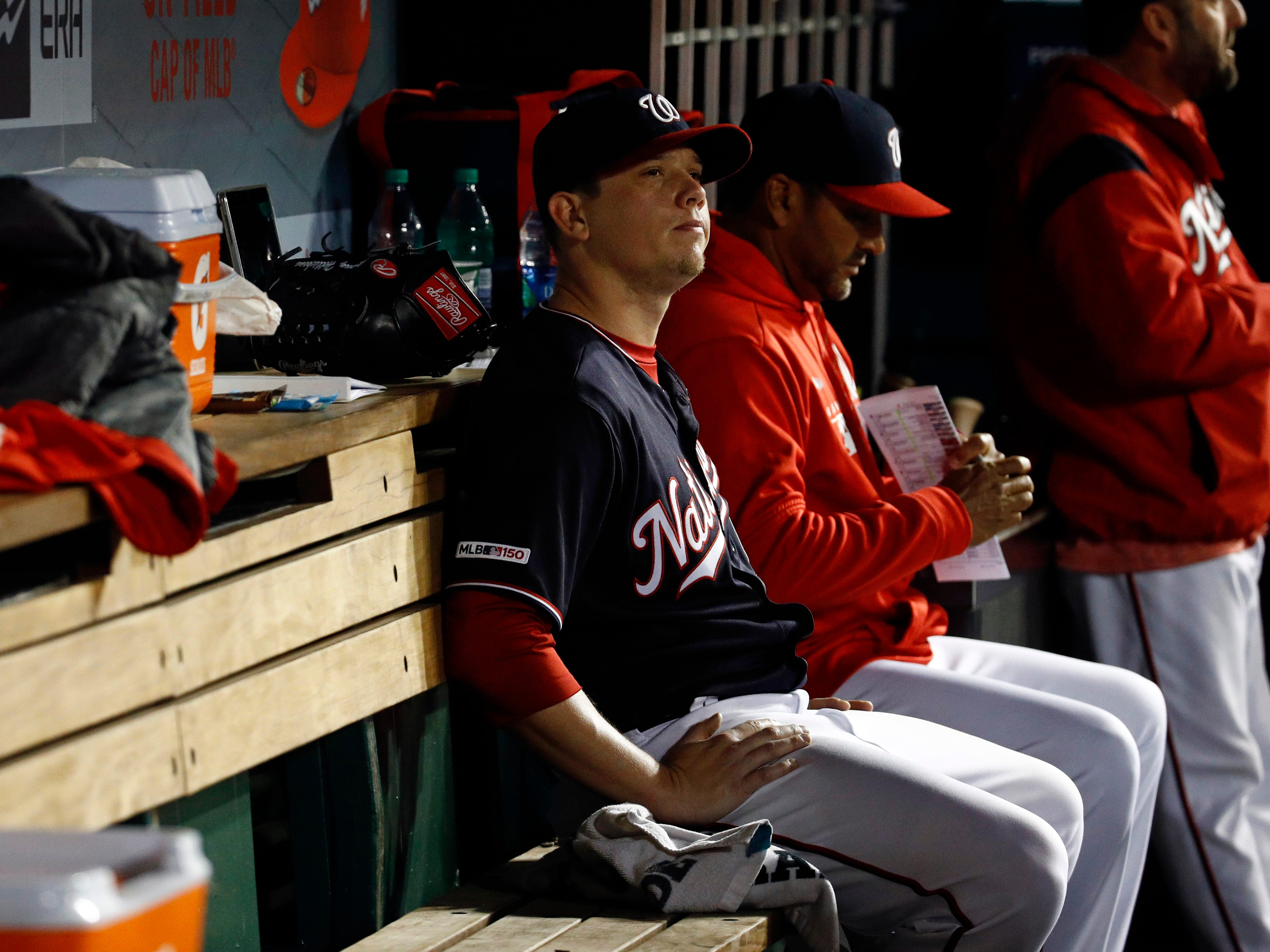 Washington Nationals starting pitcher Jeremy Hellickson, left, sits in the dugout next to manager Dave Martinez after being removed during the sixth inning of the team's game against the New York Mets, Tuesday, May 14, 2019, in Washington.
