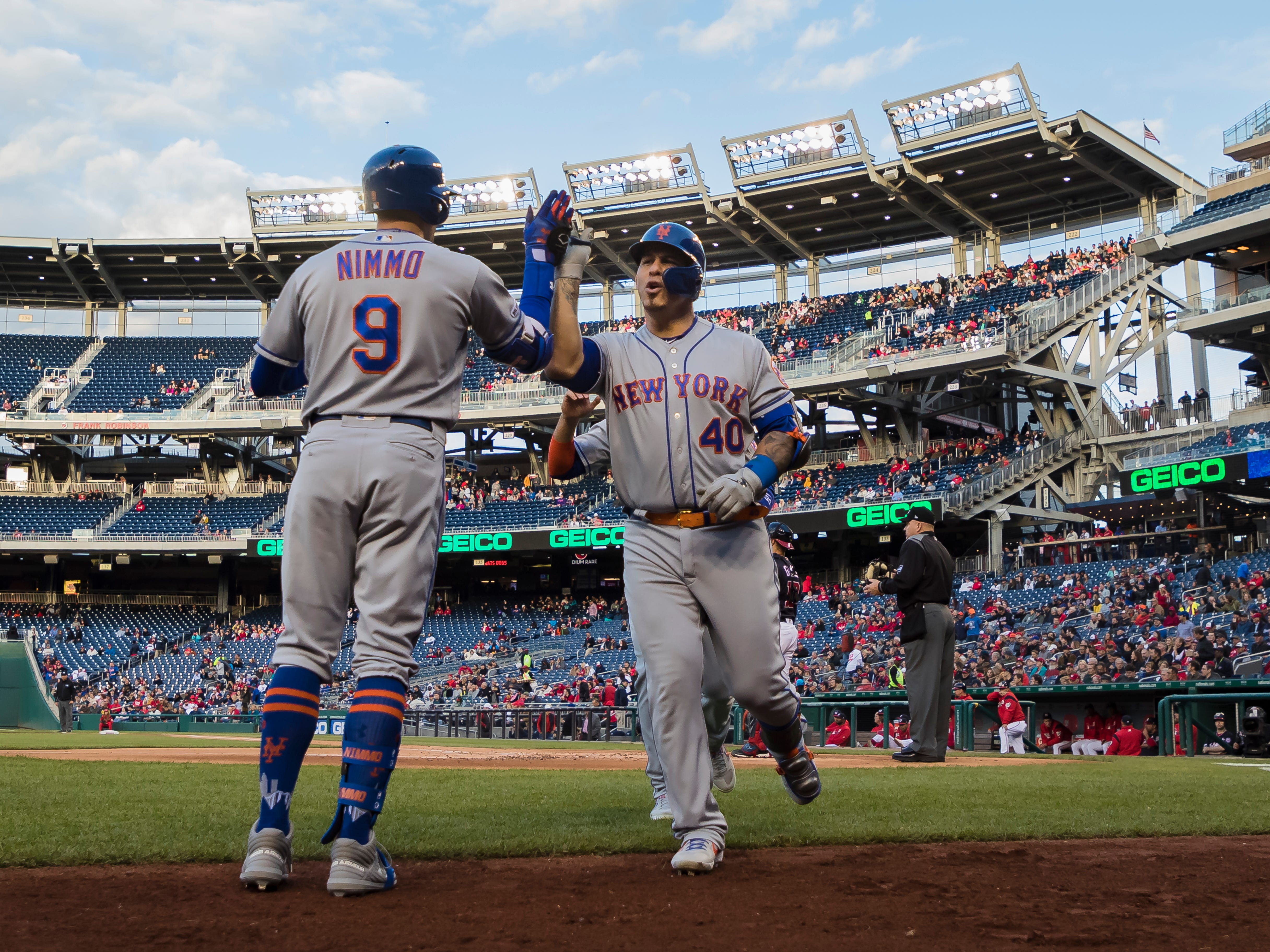 Wilson Ramos #40 of the New York Mets celebrates with Brandon Nimmo #9 after hitting a grand slam against the Washington Nationals during the first inning at Nationals Park on May 14, 2019 in Washington, DC.