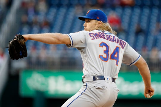 New York Mets starting pitcher Noah Syndergaard throws to a Washington Nationals batter during the first inning of a baseball game Tuesday, May 14, 2019, in Washington.