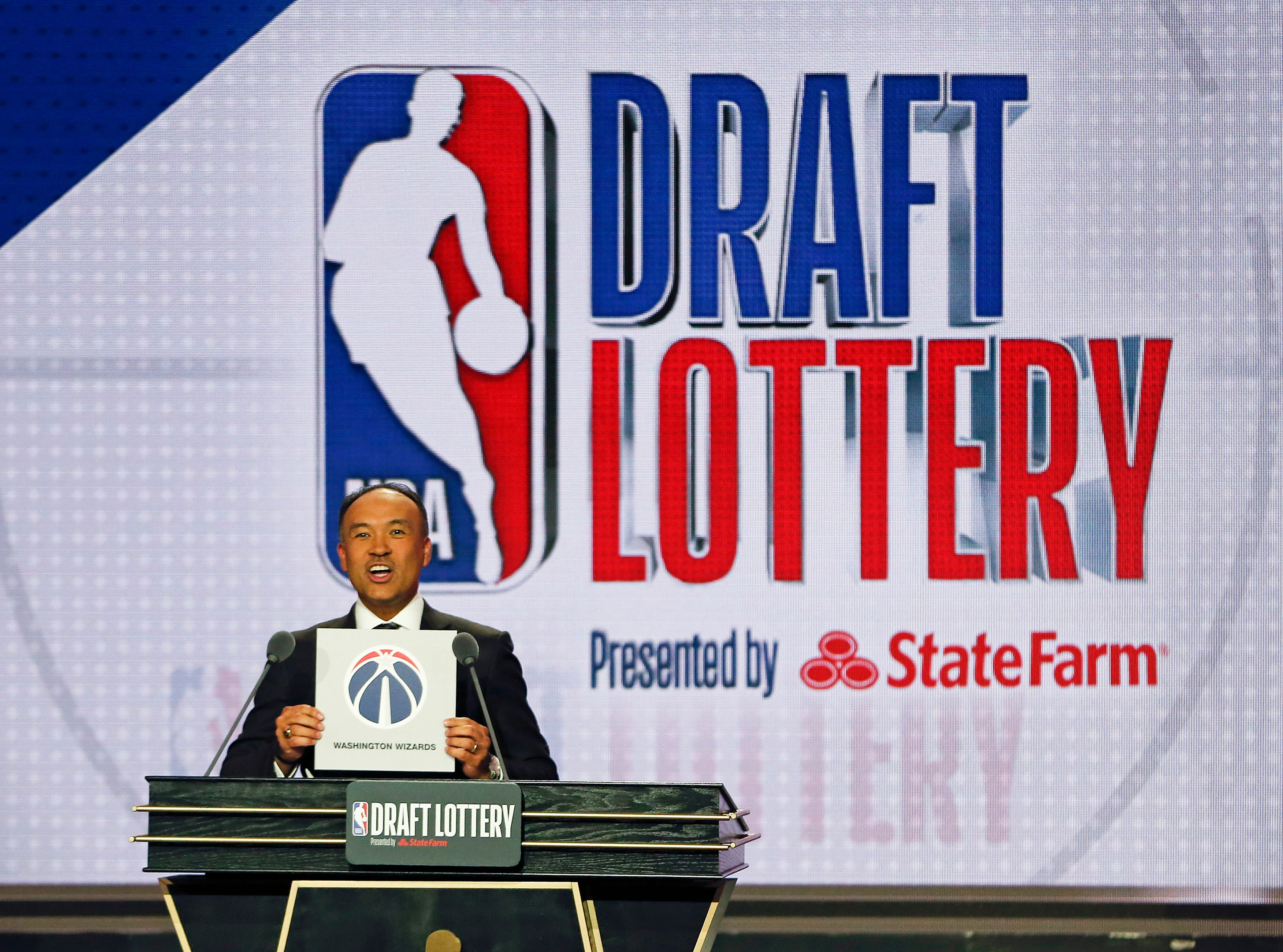 NBA Deputy Commissioner Mark Tatum announces that the Washington Wizards had won the ninth pick during the NBA basketball draft lottery Tuesday, May 14, 2019, in Chicago. (AP Photo/Nuccio DiNuzzo)