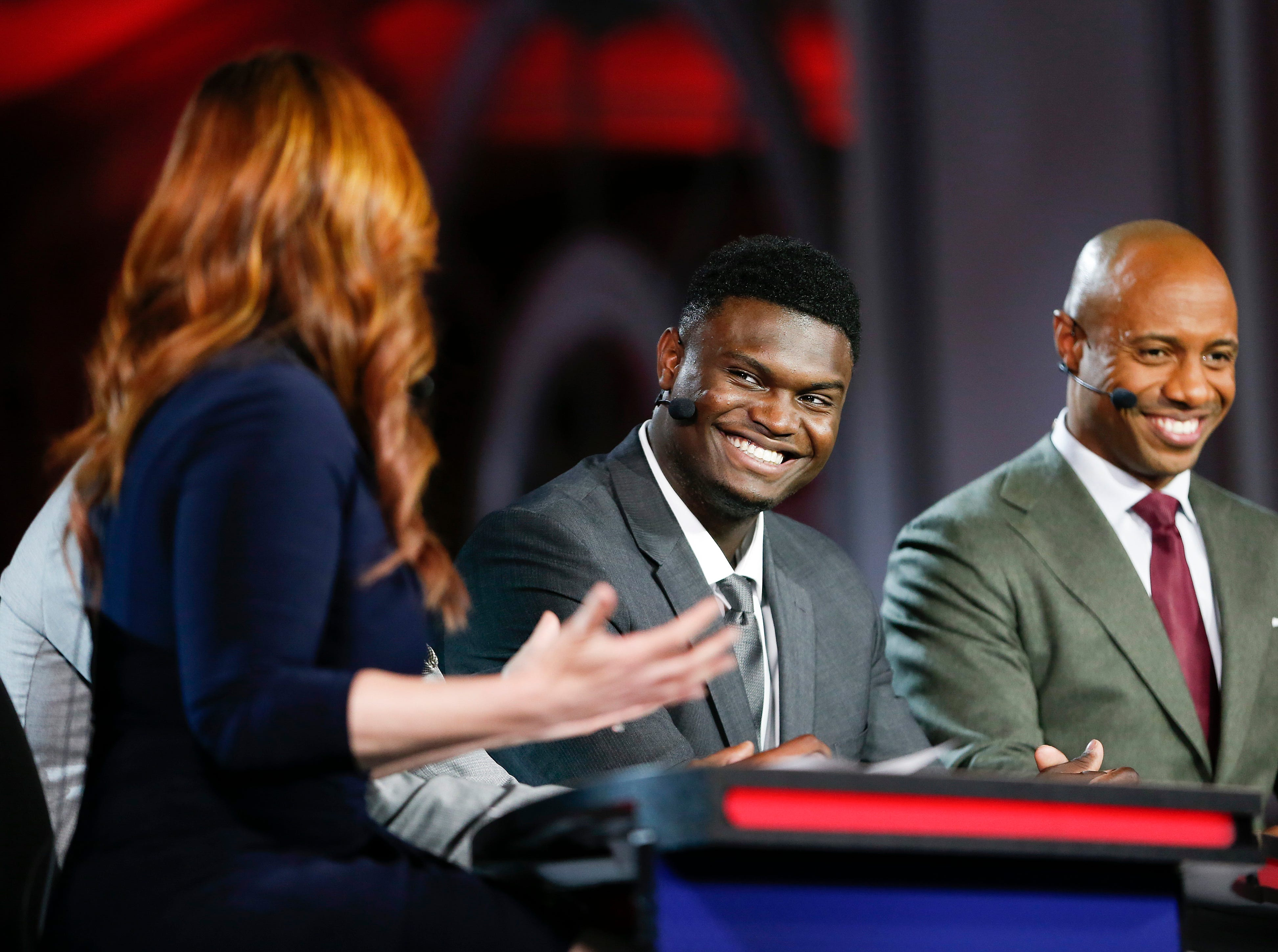 Duke's Zion Williamson, second from right, is interviewed by an ESPN reporter during the NBA basketball draft lottery Tuesday, May 14, 2019, in Chicago. (AP Photo/Nuccio DiNuzzo)
