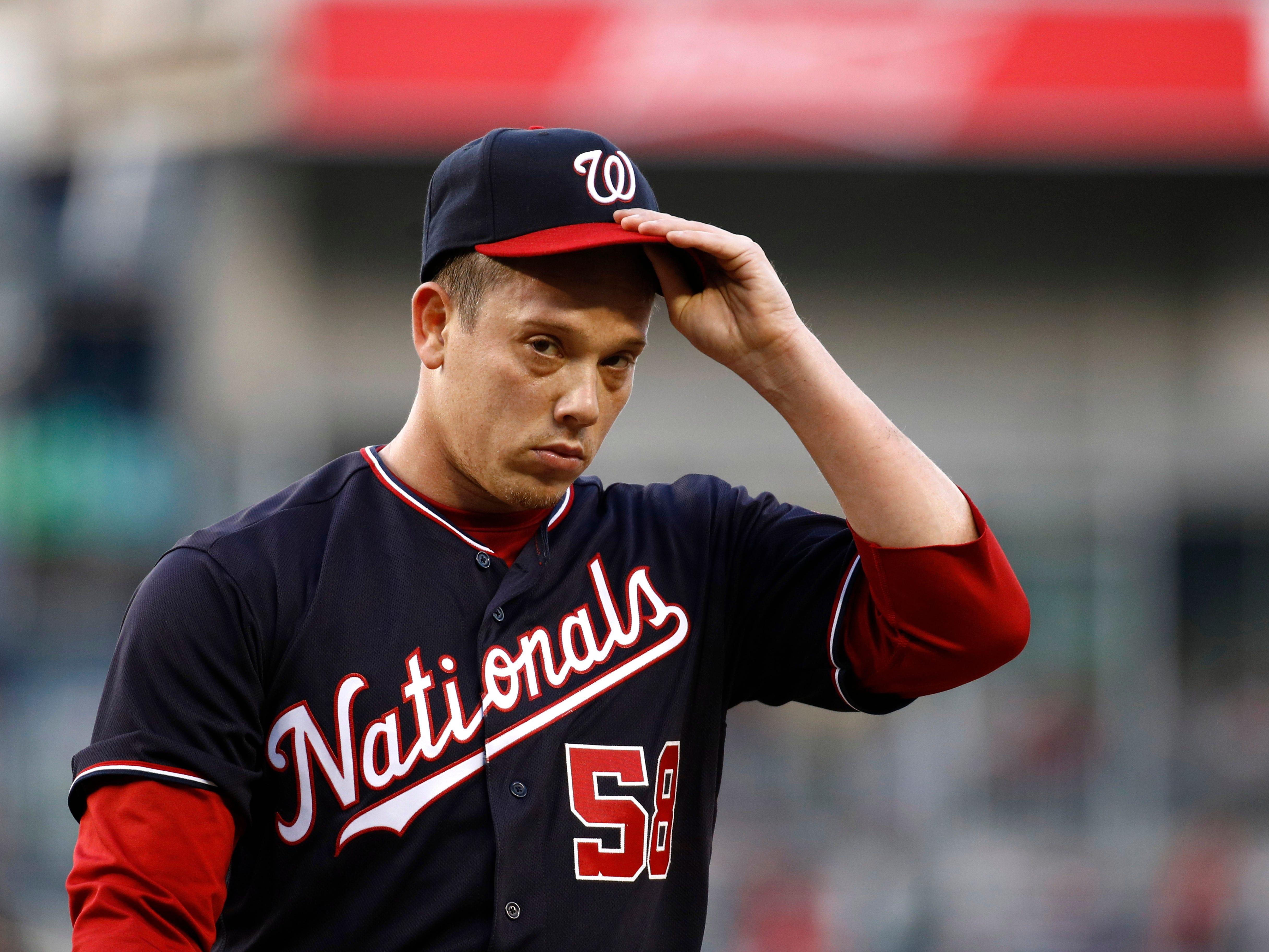Washington Nationals starting pitcher Jeremy Hellickson walks off the field in the middle of the first inning of the team's game against the New York Mets, Tuesday, May 14, 2019, in Washington. Hellickson gave up a grand slam in the inning.