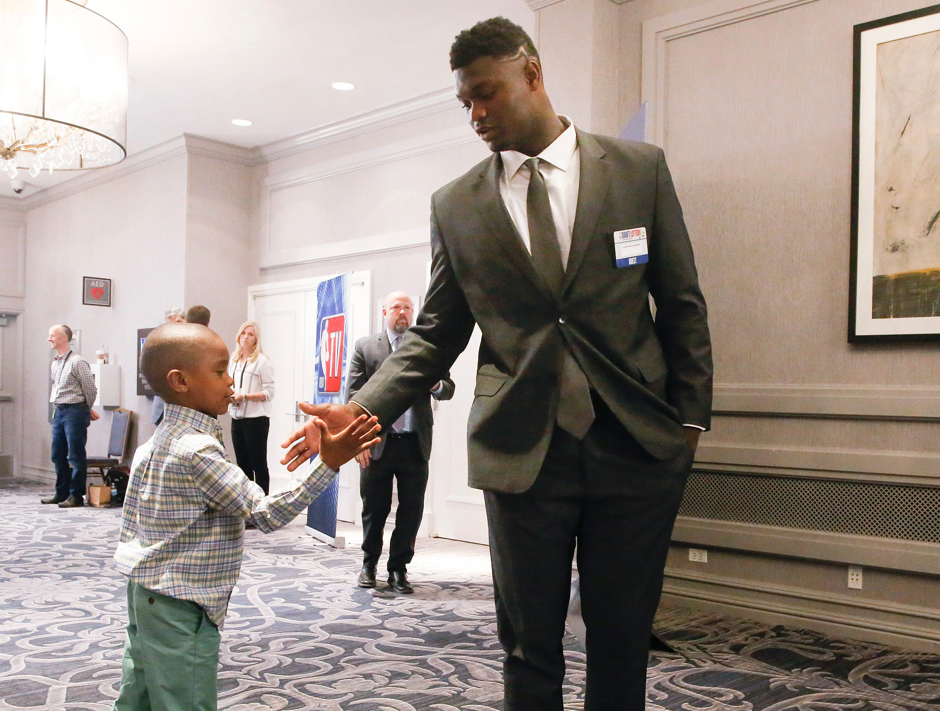 Duke's Zion Williamson, right, stands with his brother Noah Anderson before the NBA basketball draft lottery Tuesday, May 14, 2019, in Chicago. (AP Photo/Nuccio DiNuzzo)