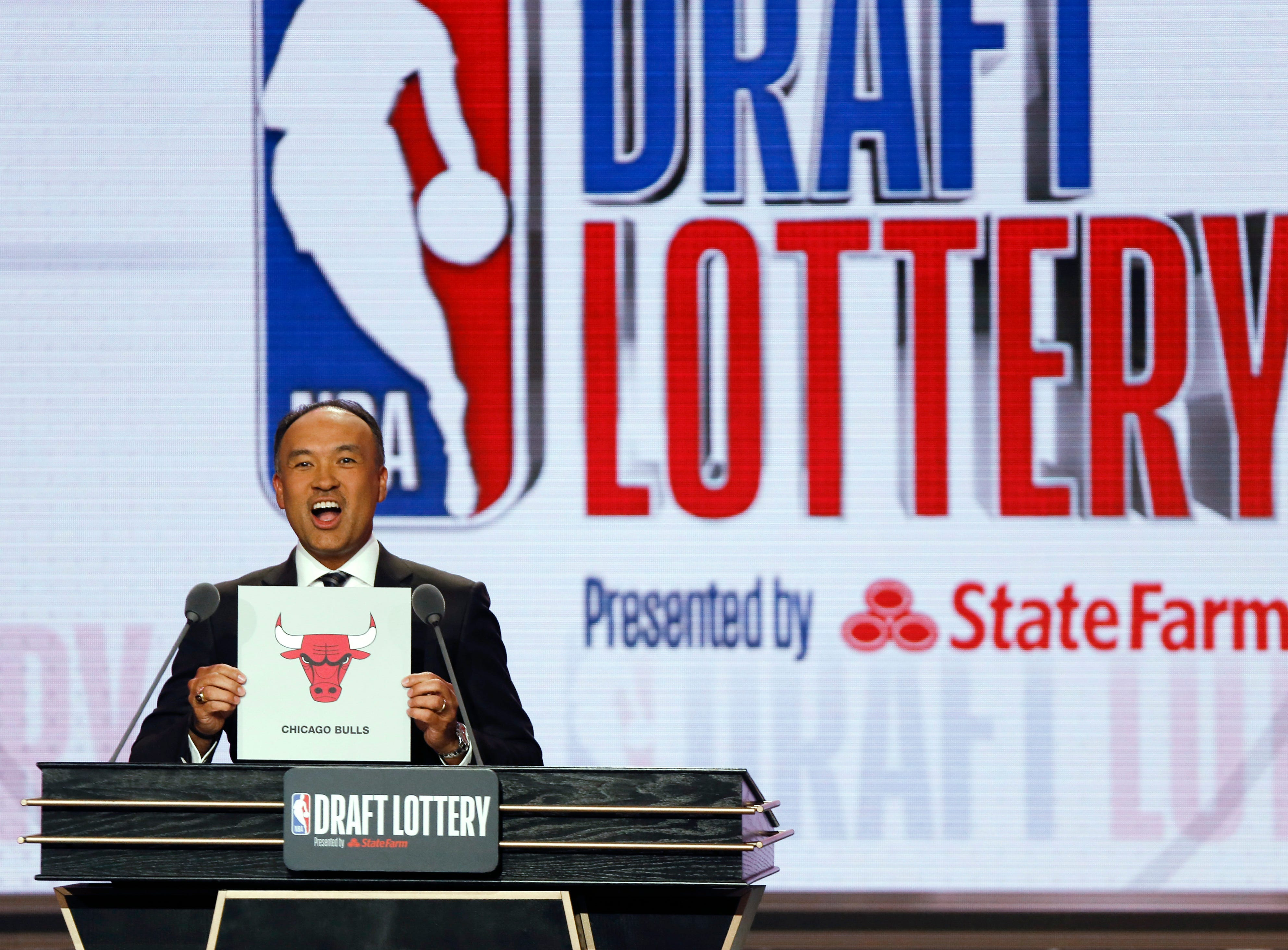NBA Deputy Commissioner Mark Tatum announces that the Chicago Bulls had won the seventh pick during the NBA basketball draft lottery Tuesday, May 14, 2019, in Chicago. (AP Photo/Nuccio DiNuzzo)