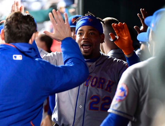 May 14, 2019; Washington, DC, USA; New York Mets first baseman Dominic Smith (22) celebrates after hitting a home run during the ninth inning against the Washington Nationals at Nationals Park.