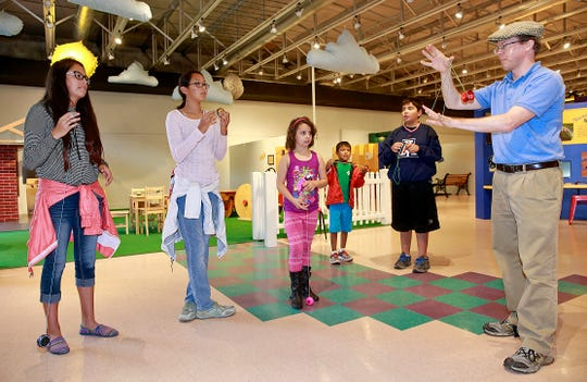 Luke Renner, right, leads a yo-yo class on Friday July 1, 2016, at the E3 Children's Museum & Science Center.