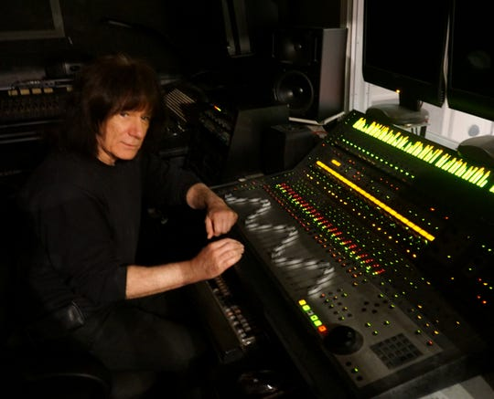 RIck Young behind his mixing board.