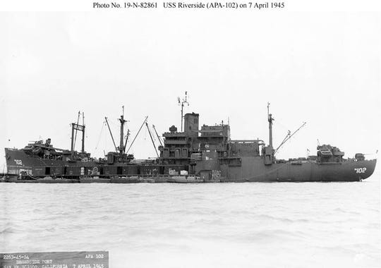 USS Riverside (APA-102) at San Francisco on April 7, 1945. The deckhouses containing the Reserve AGC spaces are clearly visible in this profile view. The rig, a goalpost forward and two single masts, was typical of the later Ingalls-built hulls after conversion. This ship also had an extra pair of booms stepped directly on the front of the main superstructure.