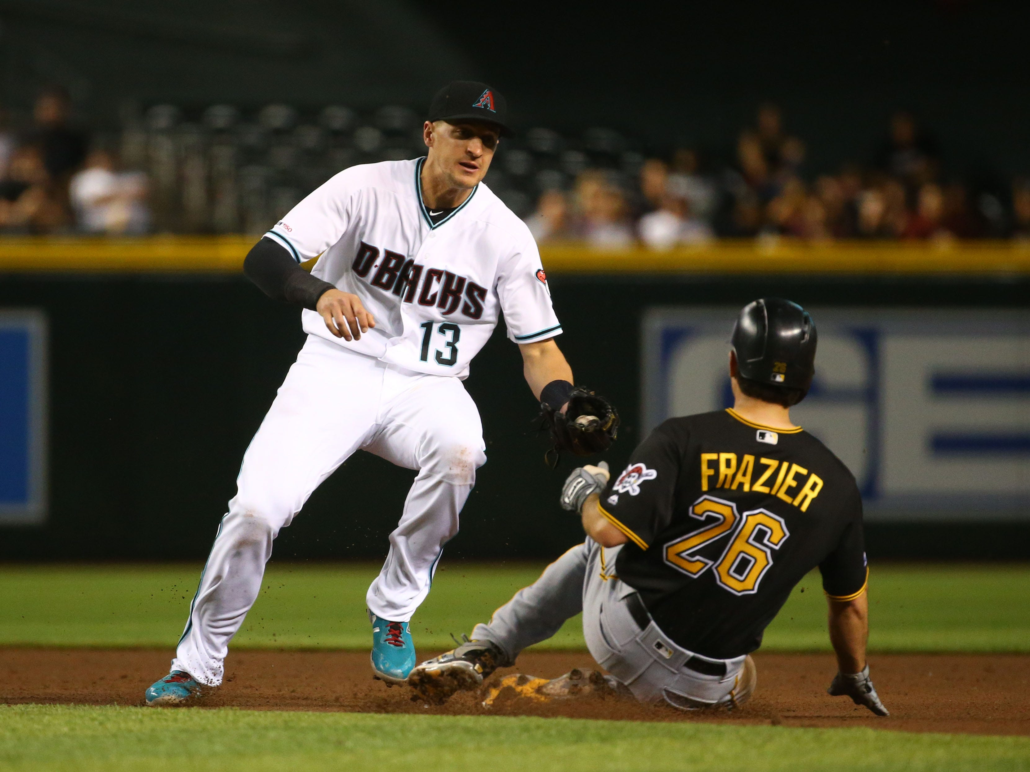 Arizona Diamondbacks Nick Ahmed tags-out Pittsburgh Pirates Adam Frazier in the fifth inning on May. 14, 2019 at Chase Field in Phoenix, Ariz.