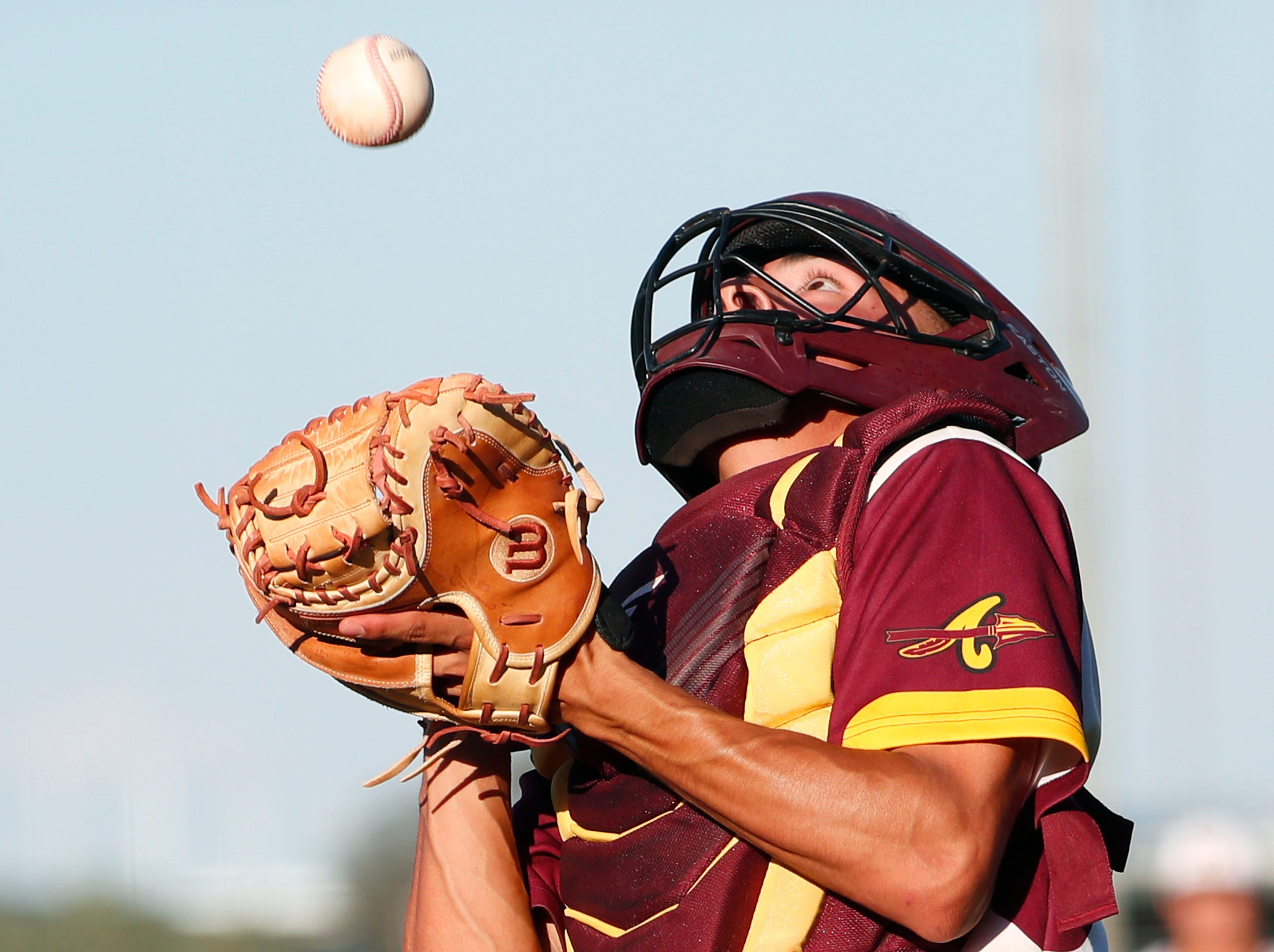 Nogales catcher Mario Duarte (8) fields a wild pitch off the backstop against Horizon during the 5A State Baseball Championship in Tempe, Ariz. May 14, 2019.
