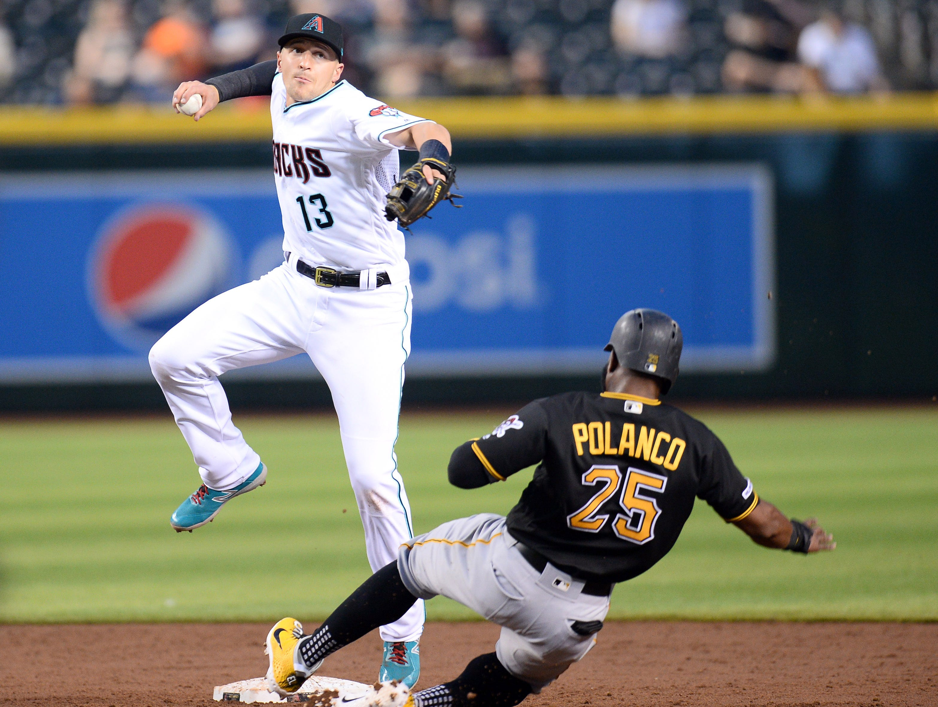 May 14, 2019; Phoenix, AZ, USA; Arizona Diamondbacks shortstop Nick Ahmed (13) throws to first base after forcing out Pittsburgh Pirates right fielder Gregory Polanco (25) at second during the third inning at Chase Field. Mandatory Credit: Joe Camporeale-USA TODAY Sports