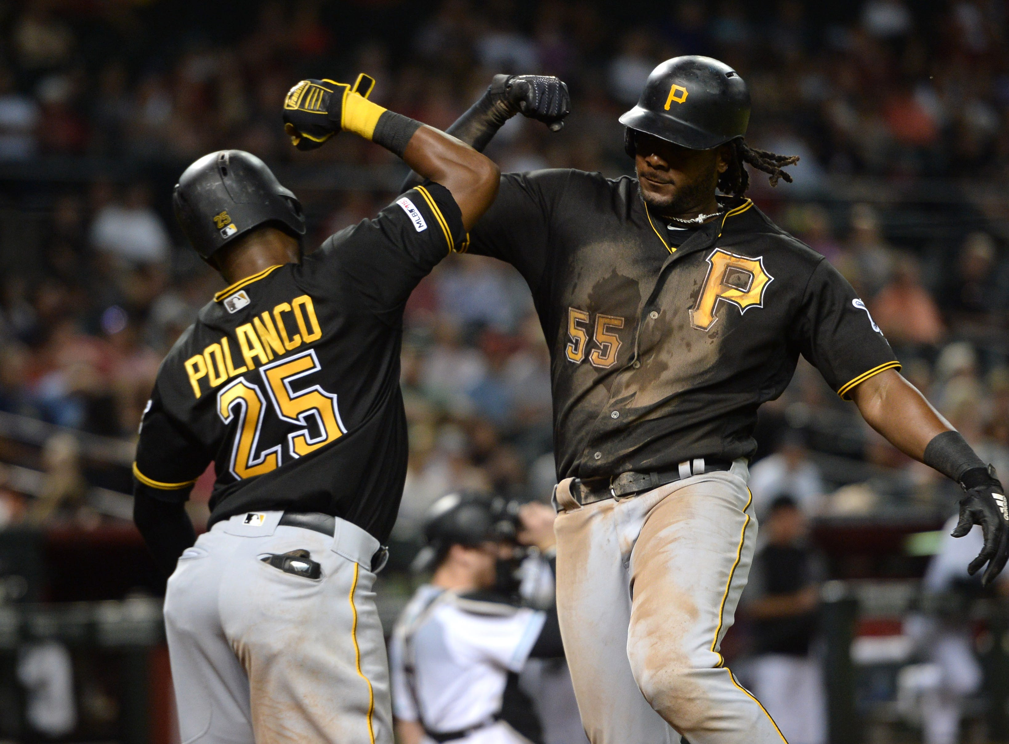 May 14, 2019; Phoenix, AZ, USA; Pittsburgh Pirates first baseman Josh Bell (55) celebrates with right fielder Gregory Polanco (25) after hitting a two run home run against the Arizona Diamondbacks during the fifth inning at Chase Field. Mandatory Credit: Joe Camporeale-USA TODAY Sports