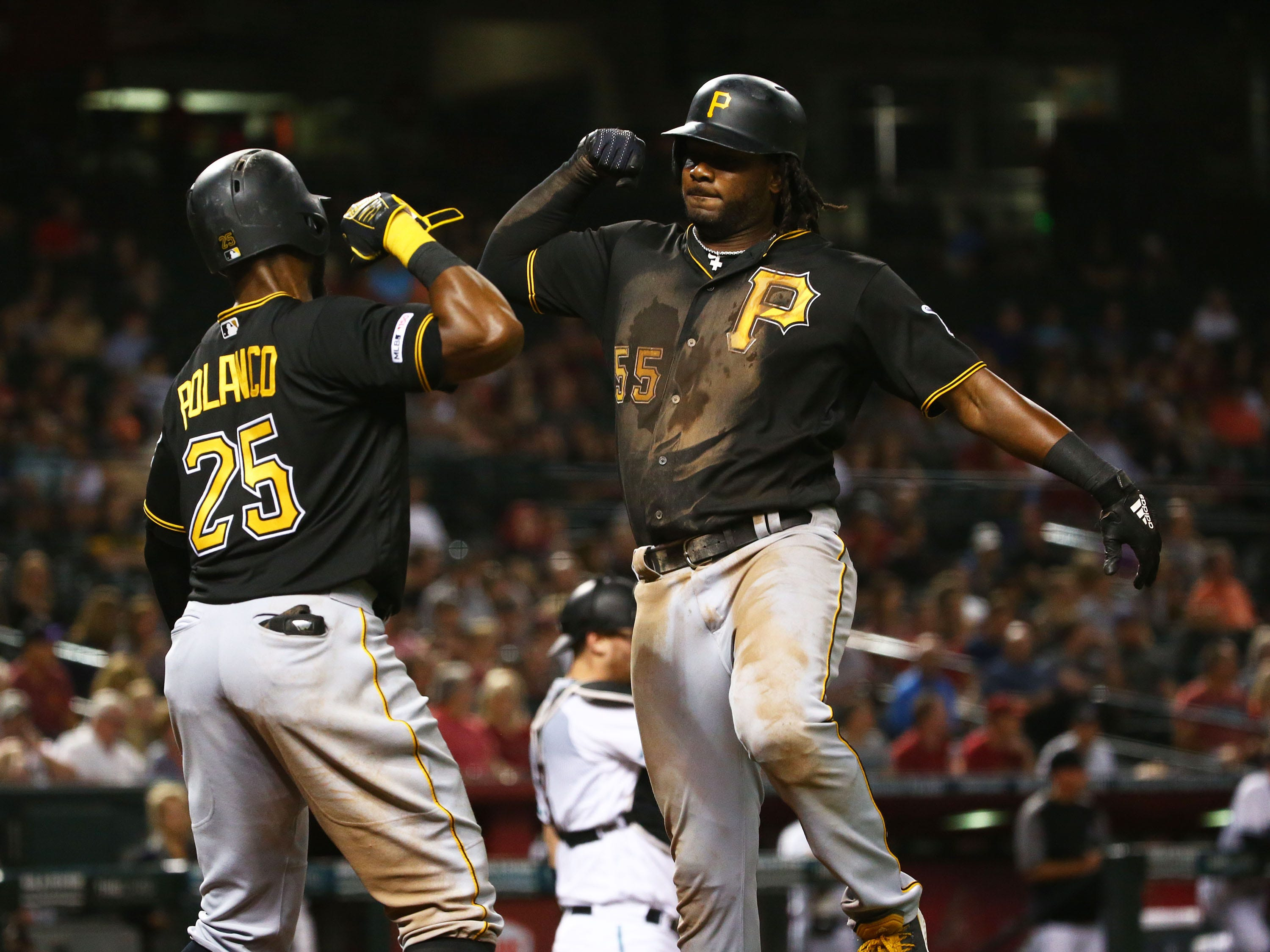 Pittsburgh Pirates Josh Bell (right) reacts after hitting a 2-run home run off Arizona Diamondbacks pitcher Luke Weaver in the fifth inning on May. 14, 2019 at Chase Field in Phoenix, Ariz.