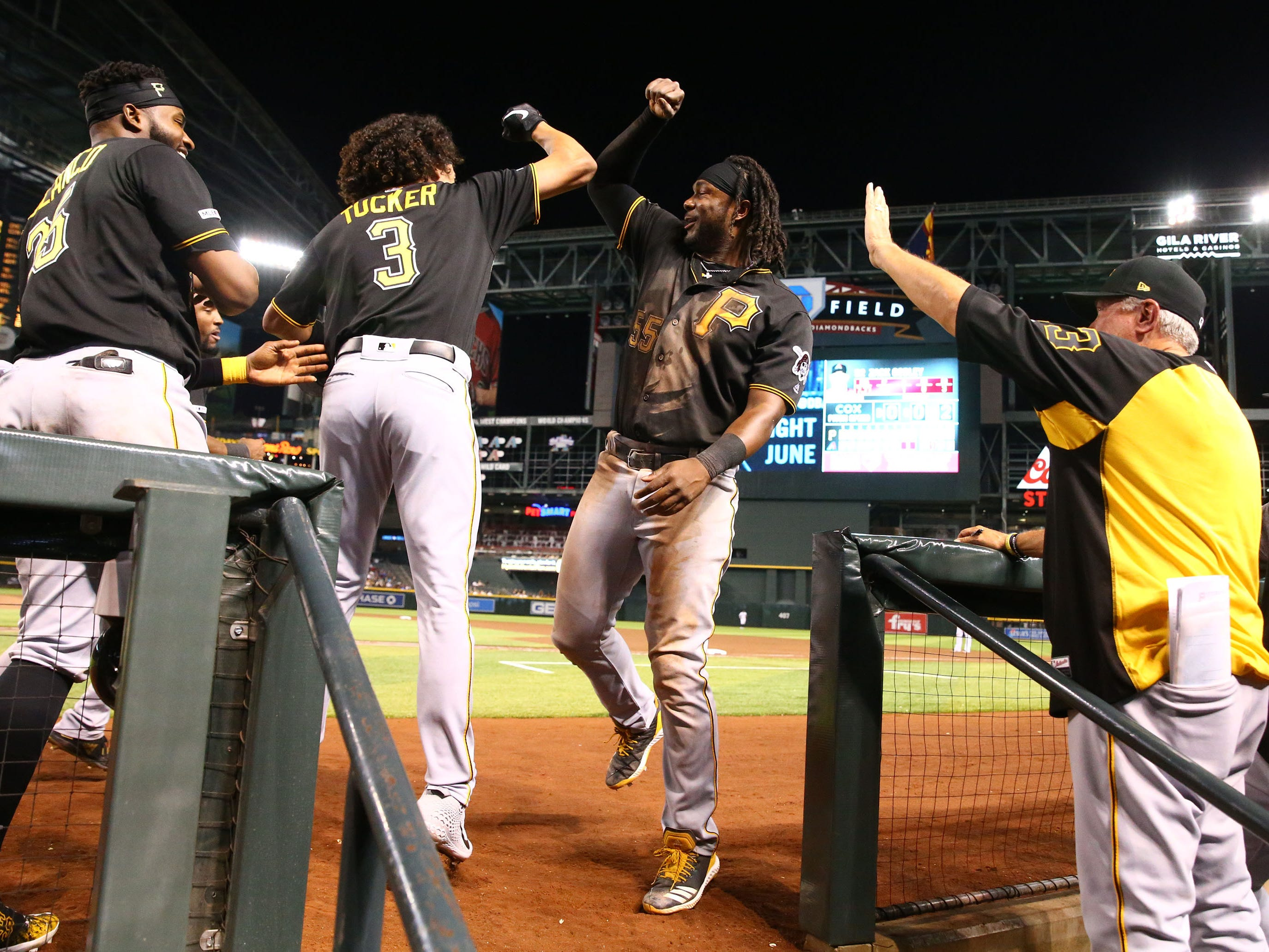 Pittsburgh Pirates' Cole Tucker (3) celebrates after hitting a 2-run home run off Arizona Diamondbacks pitcher Zack Godley in the eighth inning on May. 14, 2019 at Chase Field in Phoenix, Ariz.