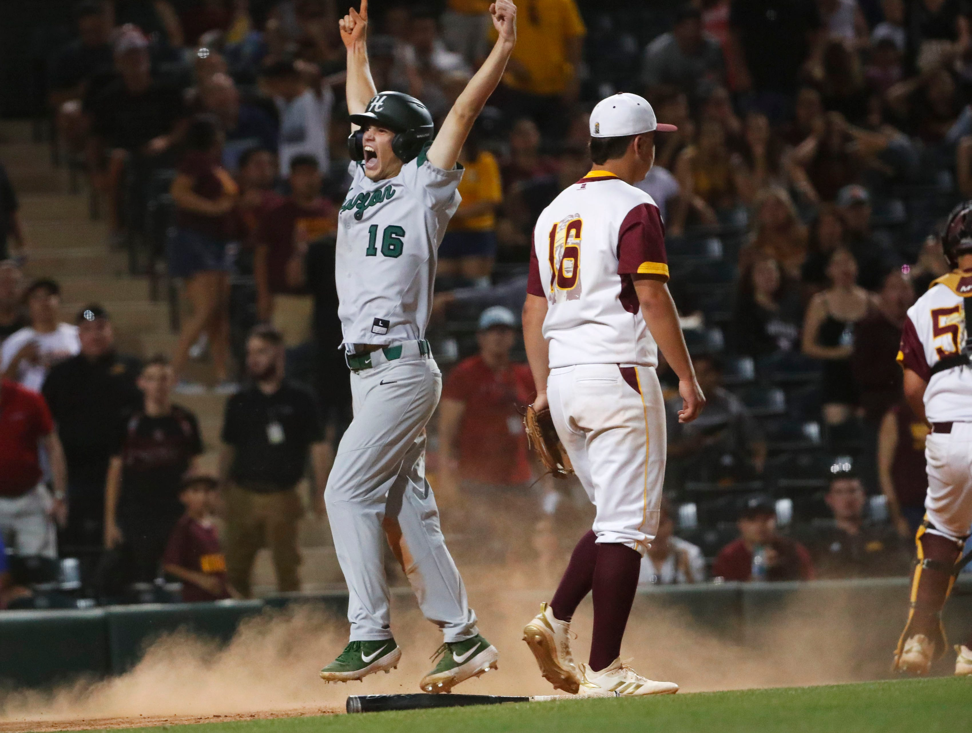 Horizon's Brady Miltenberger (16) scores against Nogales in the 15th inning during the 5A State Baseball Championship in Tempe, Ariz. May 14, 2019.