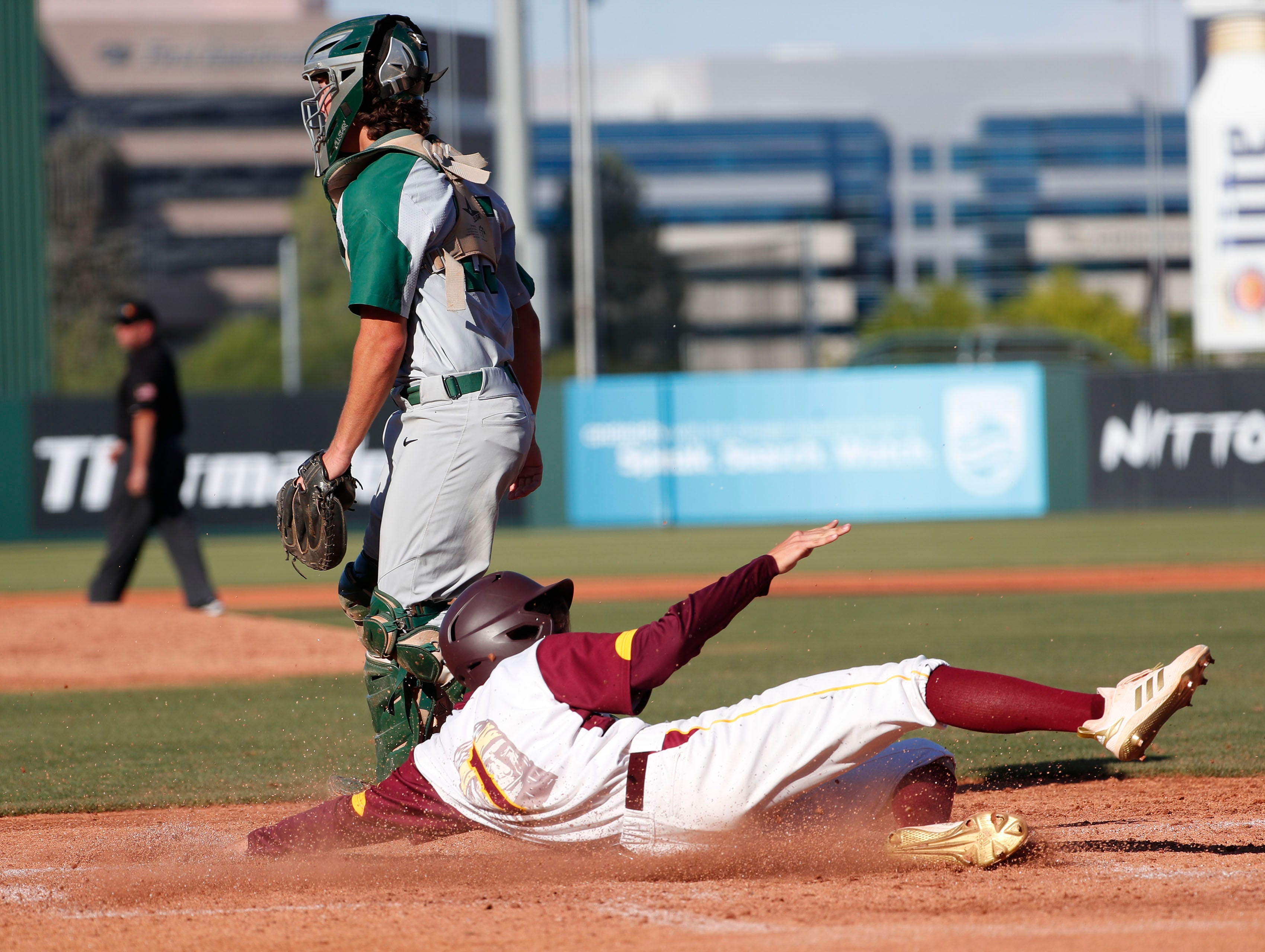 Nogales' Luis Rodriguez (1) scores against Horizon during the 5A State Baseball Championship in Tempe, Ariz. May 14, 2019.