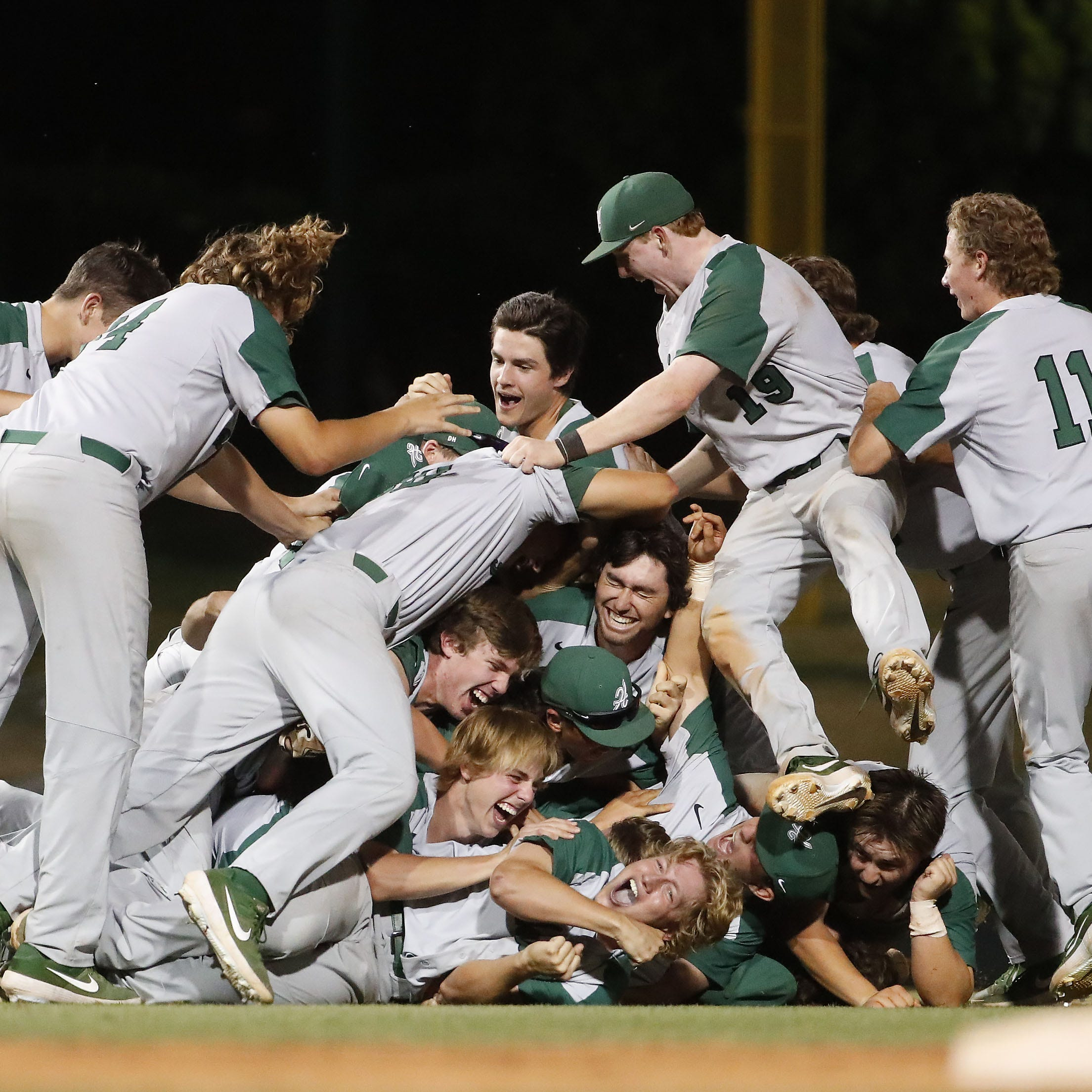 Horizon players celebrate after beating Nogales 7-4 in 16 innings to win the 5A State Baseball Championship in Tempe, Ariz. May 14, 2019.