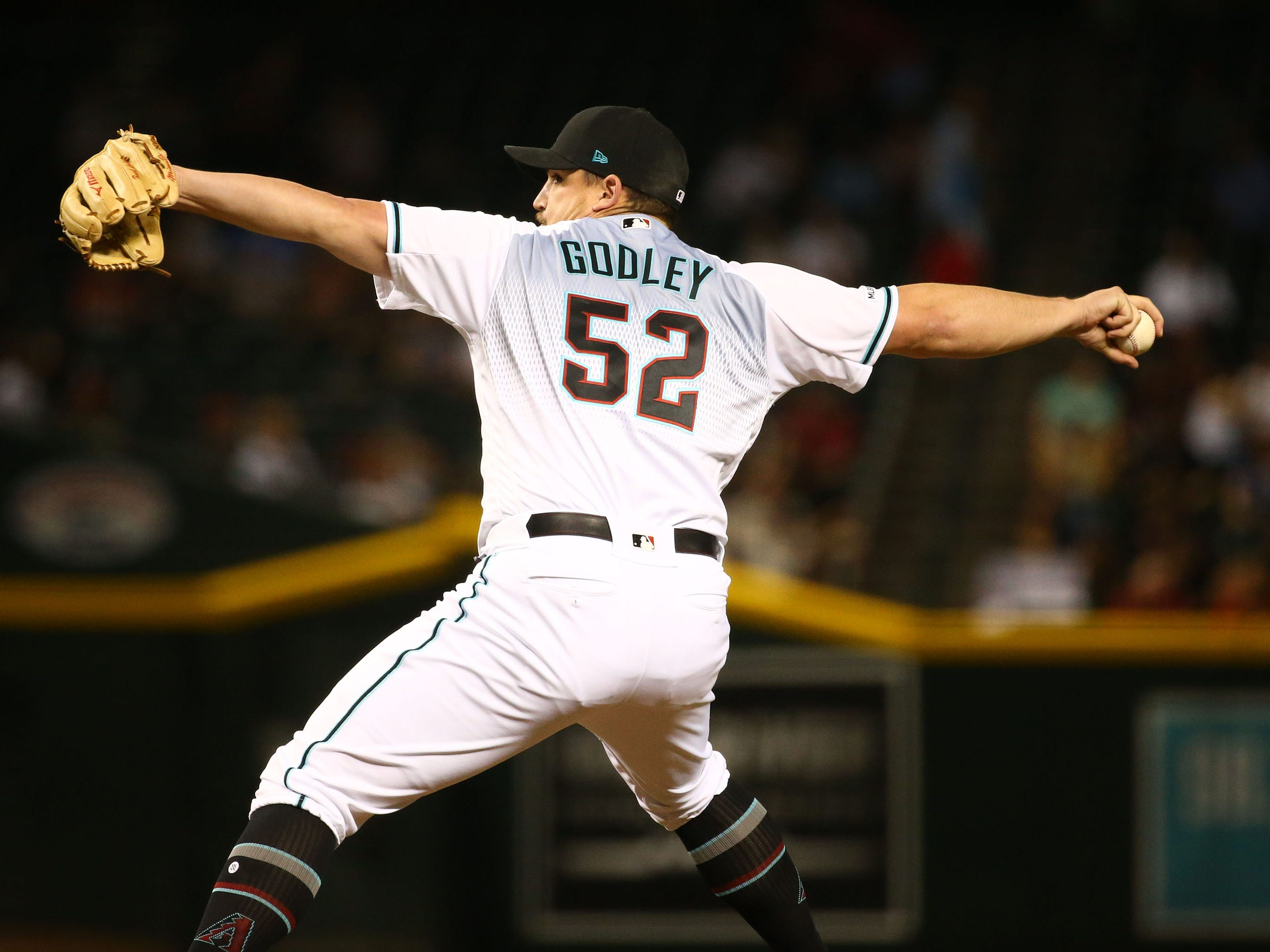Arizona Diamondbacks pitcher 	Zack Godley throws to the Pittsburgh Pirates in the eighth inning on May. 14, 2019 at Chase Field in Phoenix, Ariz.