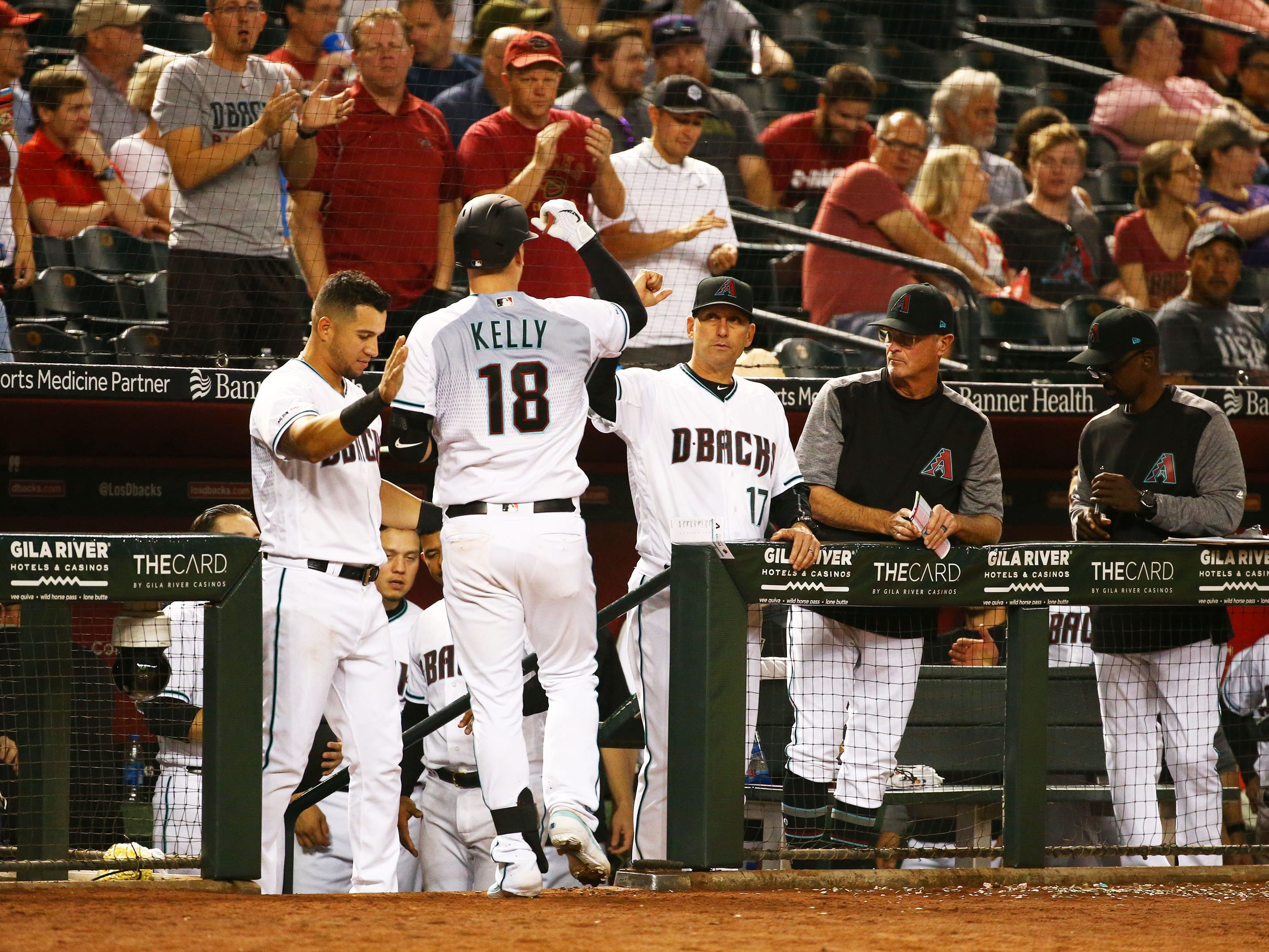 Arizona Diamondbacks Carson Kelly (18) celebrates after hitting a home run against the Pittsburgh Pirates in the eighth inning on May. 14, 2019 at Chase Field in Phoenix, Ariz.