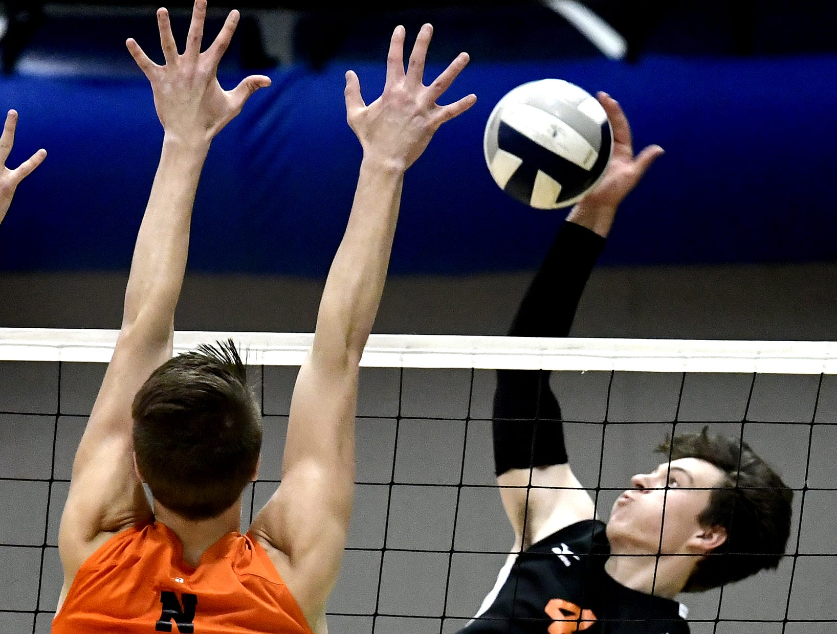 Central York's Matt Minkin tries to get the ball past Northeastern's Joel Braswell in the York-Adams boys' volleyball championship match at Dallastown Tuesday, May 14, 2019. Bill Kalina photo
