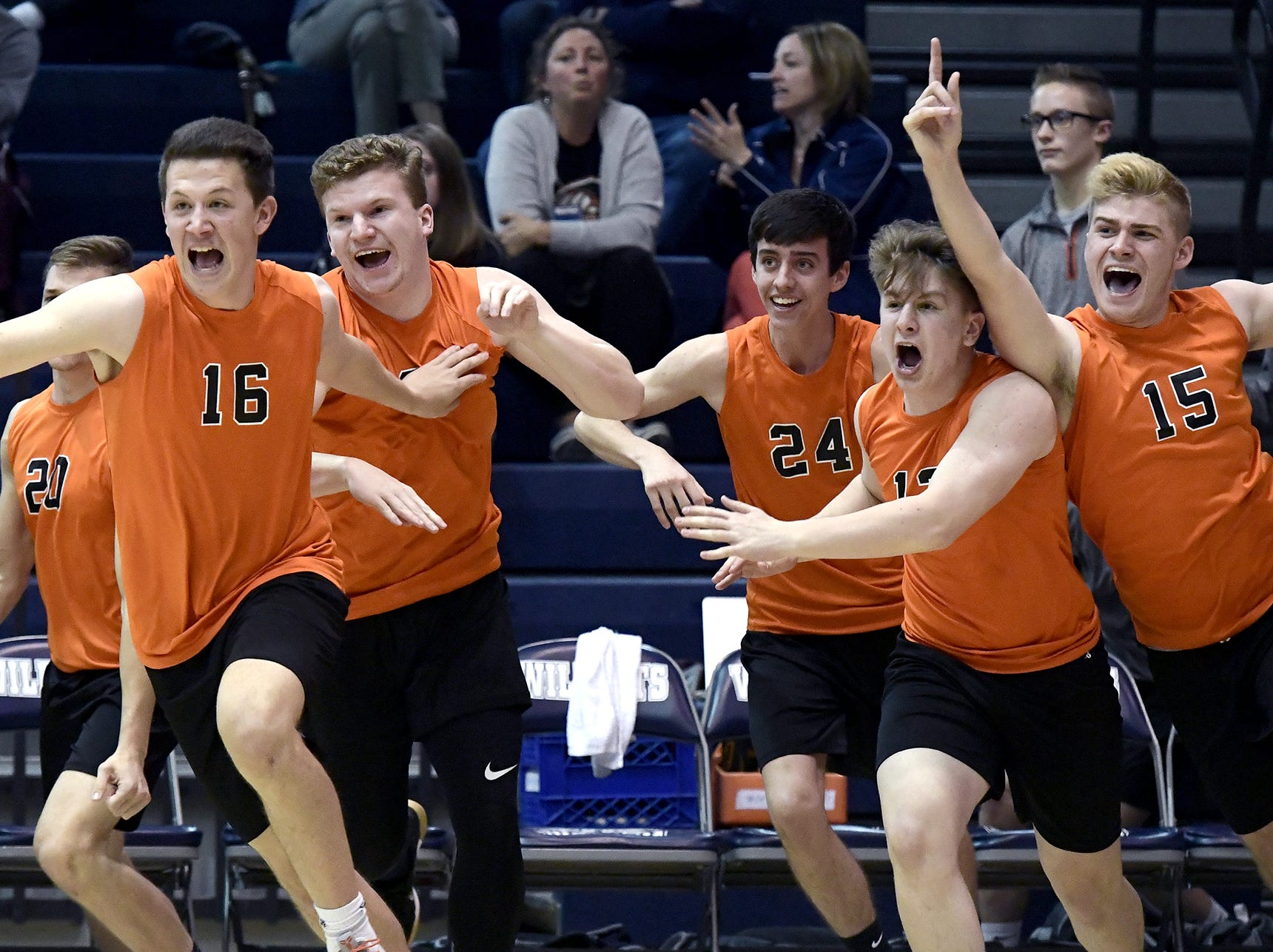 Northeastern's bench clears to celebrate the winning point over Central York in the York-Adams boys' volleyball championship match at Dallastown Tuesday, May 14, 2019. Bill Kalina photo