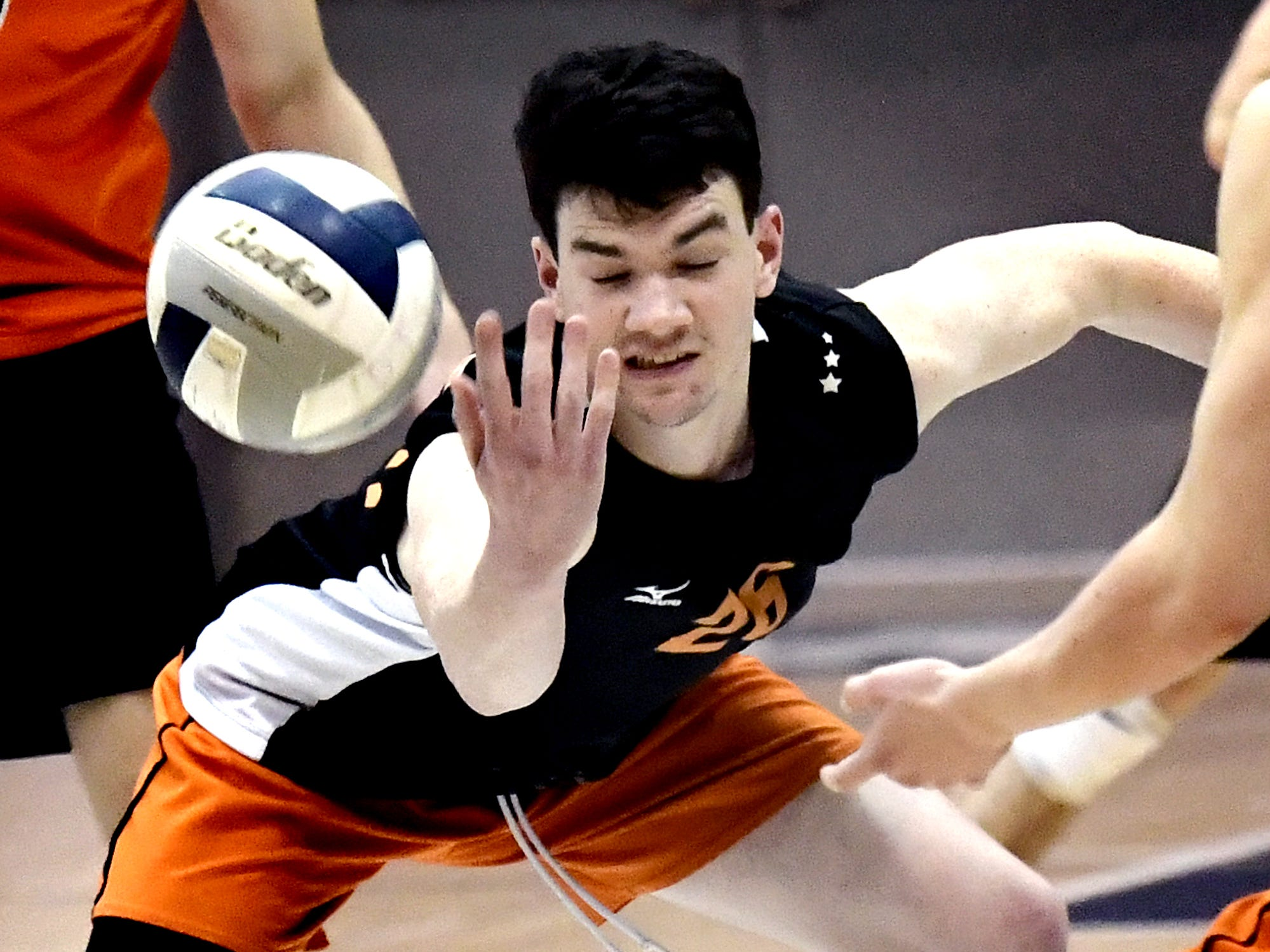 Central York's Eric Bowman saves against Northeastern in the York-Adams boys' volleyball championship match at Dallastown Tuesday, May 14, 2019. Bill Kalina photo