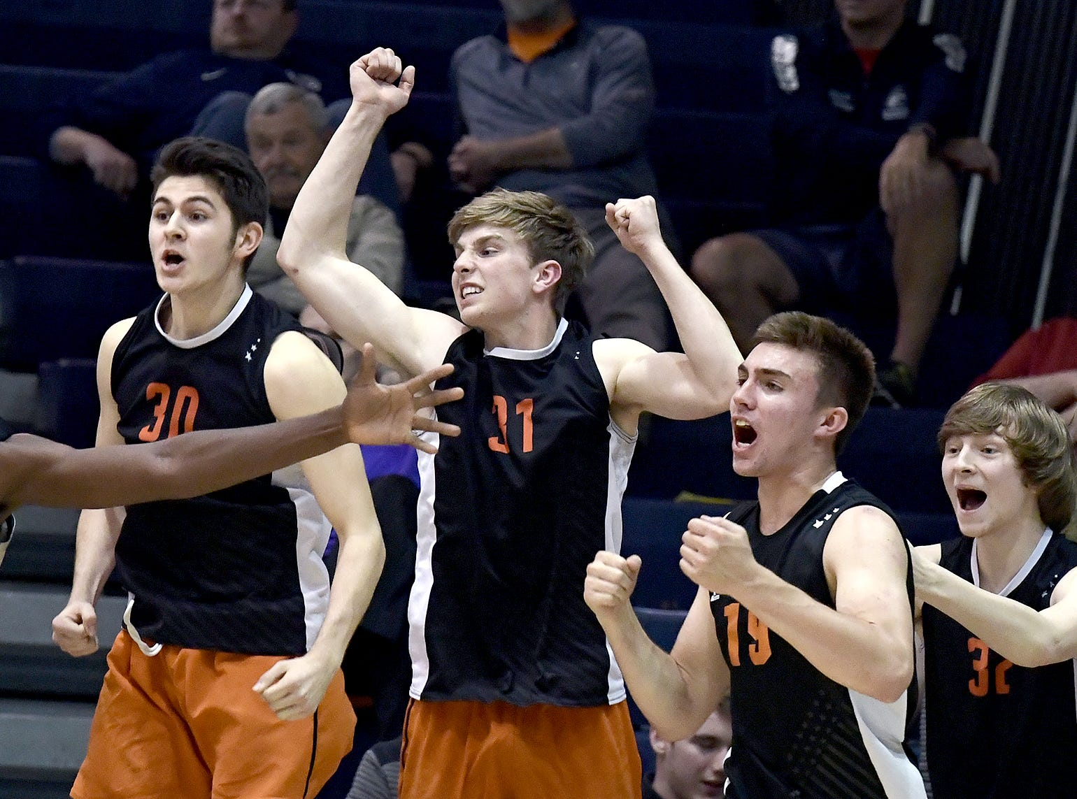 Central York's bench celebrates a game 3 win over Northeastern in the York-Adams boys' volleyball championship match at Dallastown Tuesday, May 14, 2019. Bill Kalina photo